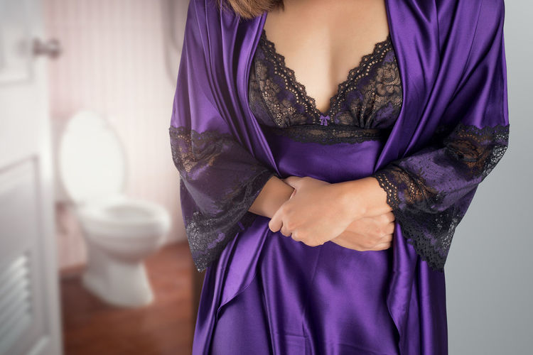 The woman in purple satin nightgown wake up for go to restroom Abdomen Abdominal Ache Bathroom Belly Body Part Cramps Diarrhea Diarrhoea Disease Dyspepsia Kidney Nightgown Pain Peeing Problem Purple Restroom Satin Stomach Stomachache Syndrome Tummy Waist Woman