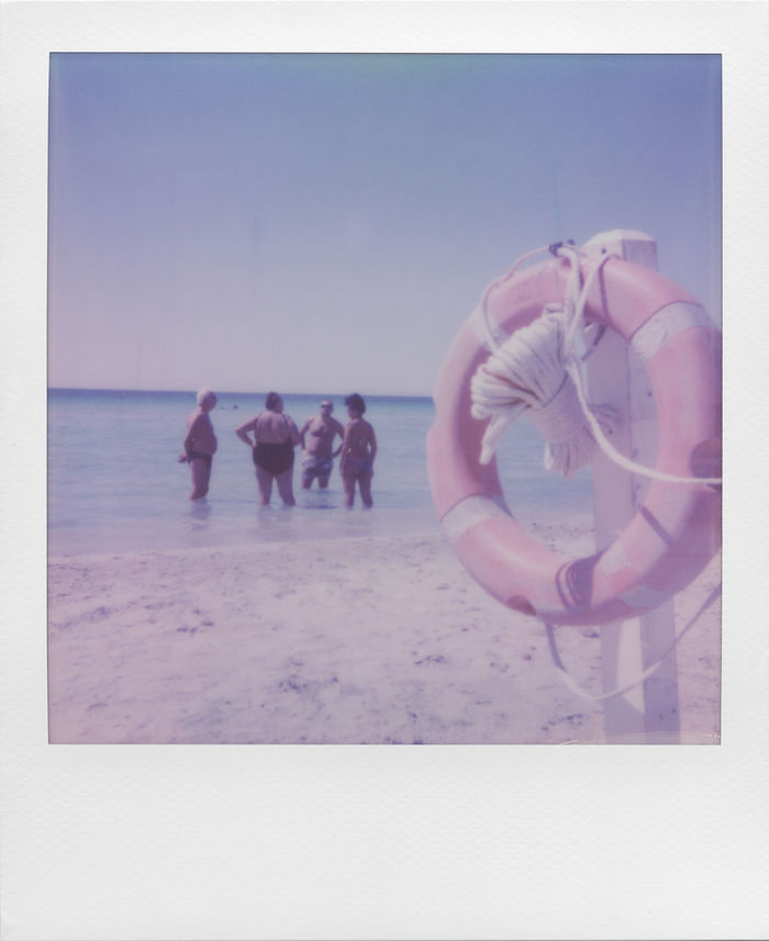 """""""The comfort of a memory"""" Camera: Impossible I-1, Film: Impossible 600 Color Analogue Analogue Photography I1 Instant Photography Vacations Analog Analog Photography Beach Blue Clear Sky Day Horizon Over Water Instant Leisure Activity Life Vest Outdoors People Real People Sand Sea Seaside Sky Standing Water"""