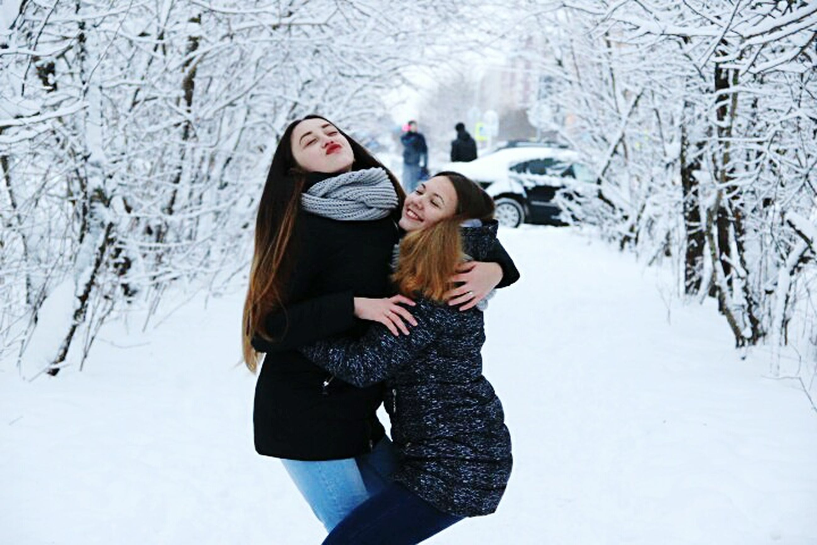 snow, winter, cold temperature, two people, friendship, young adult, long hair, bonding, warm clothing, leisure activity, togetherness, nature, fun, people, outdoors, happiness, young women, adult, vacations, smiling, day, adults only