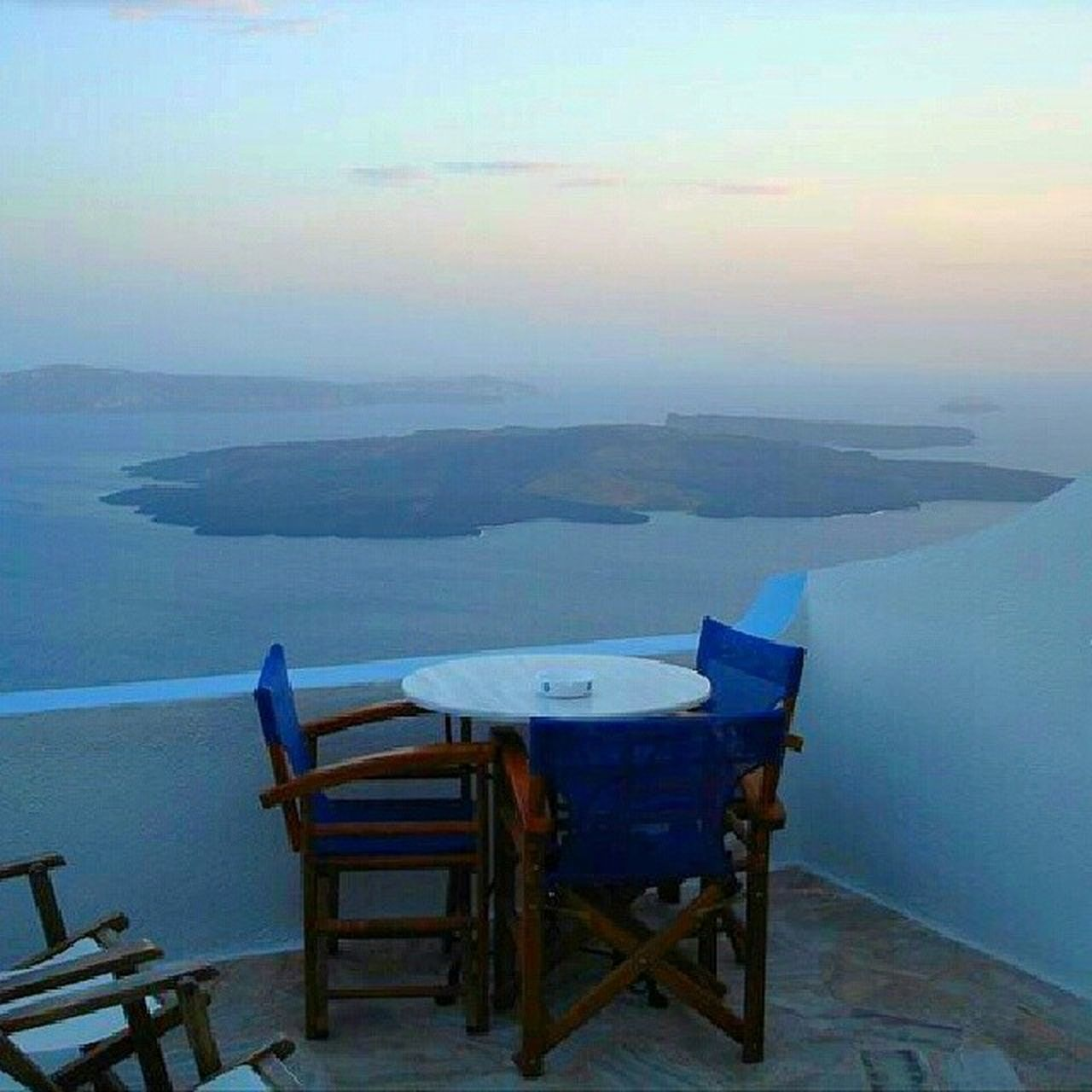 chair, table, sky, sea, scenics, landscape, nature, no people, tranquility, day, beauty in nature, outdoors, horizon over water, mountain, water