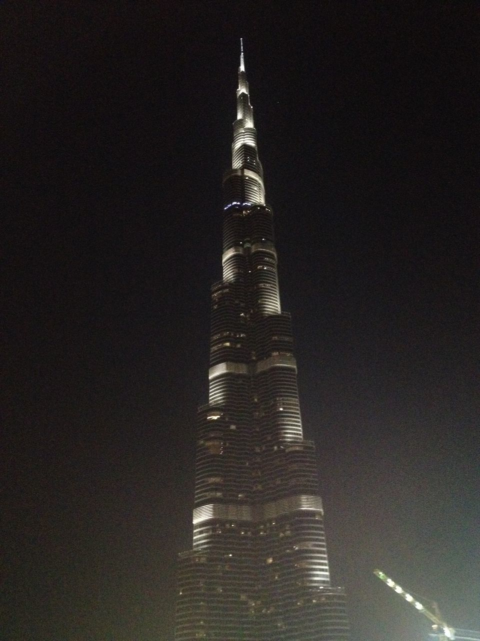 tall - high, architecture, low angle view, night, tower, travel destinations, travel, modern, tourism, built structure, skyscraper, illuminated, building exterior, no people, sky, outdoors