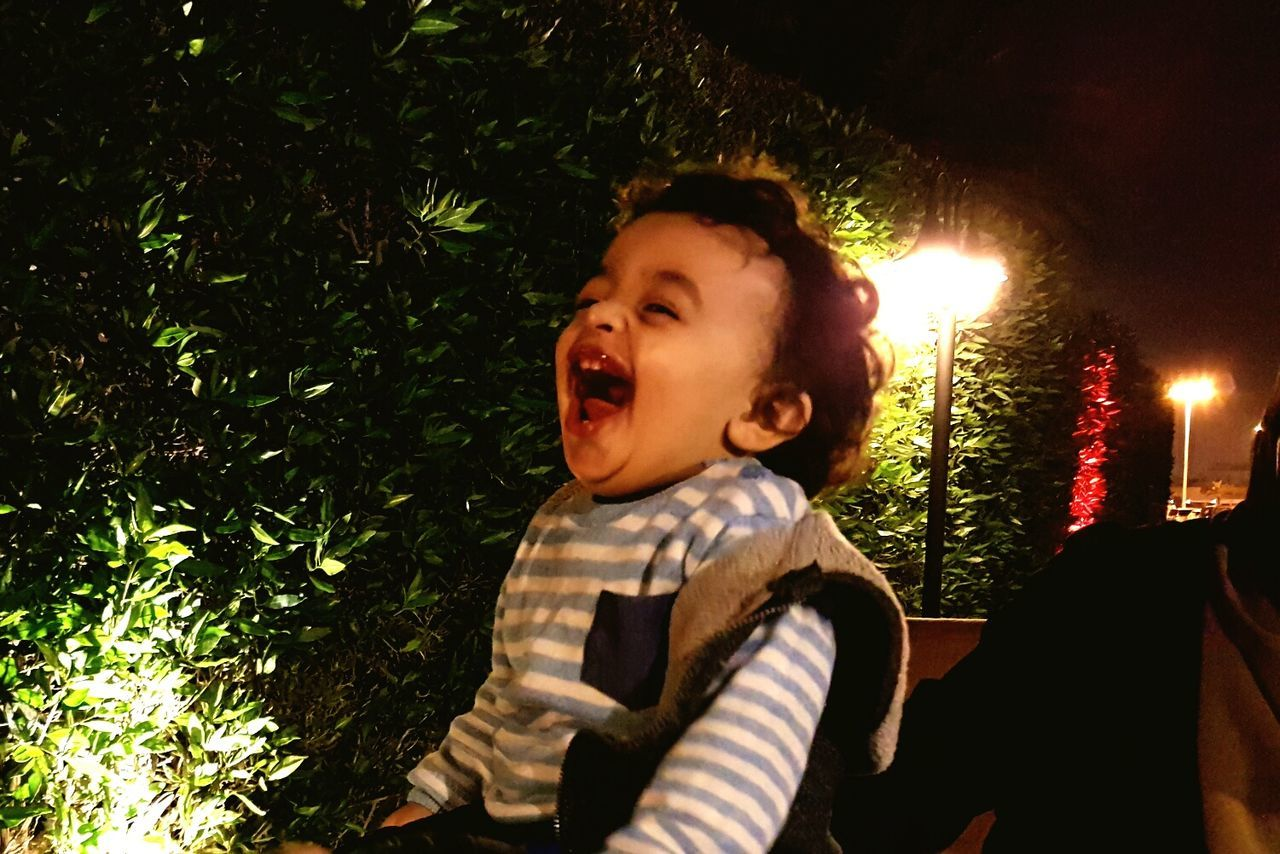 Laughing out loud Childhood Tree Real People Night Playing Outdoors Baby Babyboy Laughing Out Loud Laughing