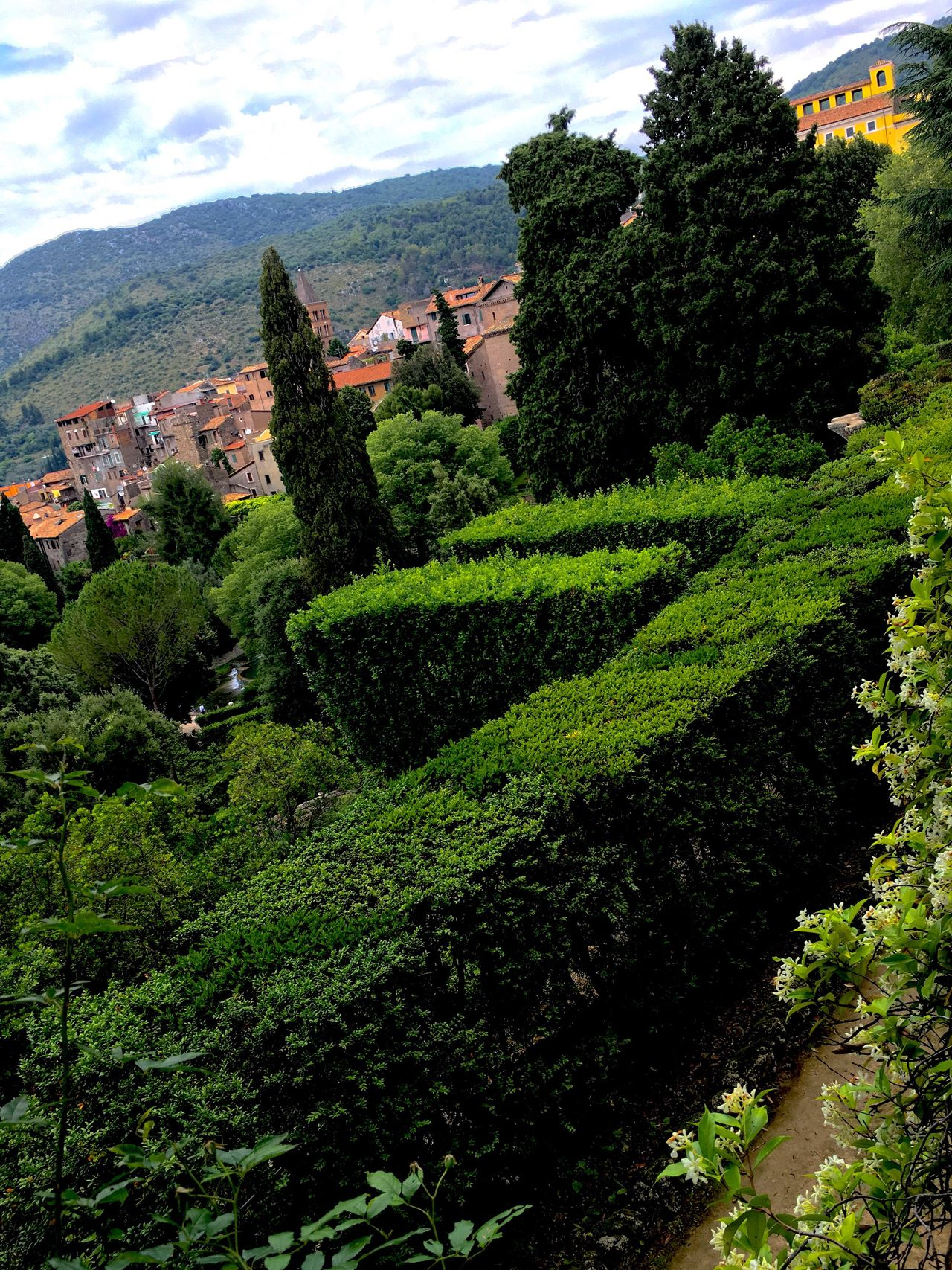Nature Growth Green Color Beauty In Nature Tree Building Exterior Scenics Outdoors Plant Built Structure Tranquil Scene Mountain Tranquility Architecture Sky Day One Person Freshness People Cityscapes Cityscape Landscape Medieval Architecture Formal Garden Villa D'Este