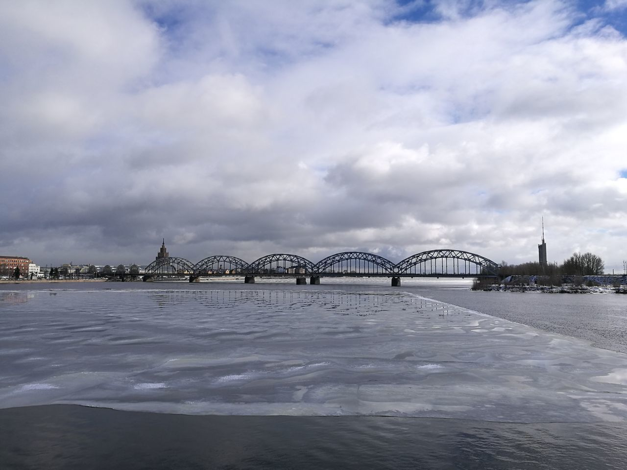 Railroad Bridge Bridge - Man Made Structure Connection River Landscape Ice Metal Bridge City Sky Cloud - Sky Spring Architecture Riga
