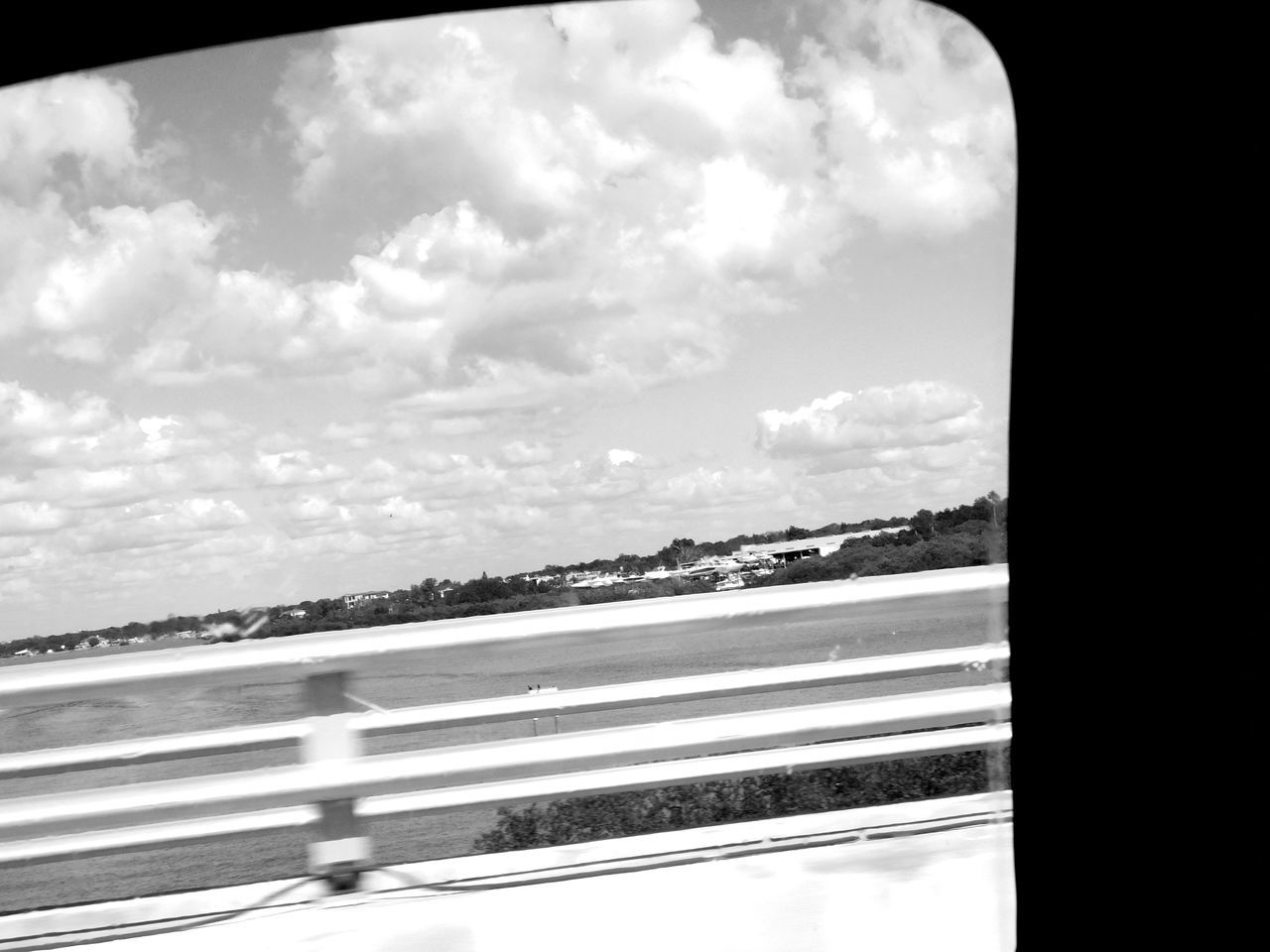 Monochrome Photography Outdoors Nature Capturing Movement Water Blackandwhite Florida Intercoastal On The Move View From The Car View From A Bridge Bridge - Man Made Structure Motion Blur In The Car Slanted Indian Rocks Beach, FL Florida Nature Beauty In Nature Blackandwhite Photography Car Ride  Traveling Travel Destinations The Drive On The Road Floridaphotographer