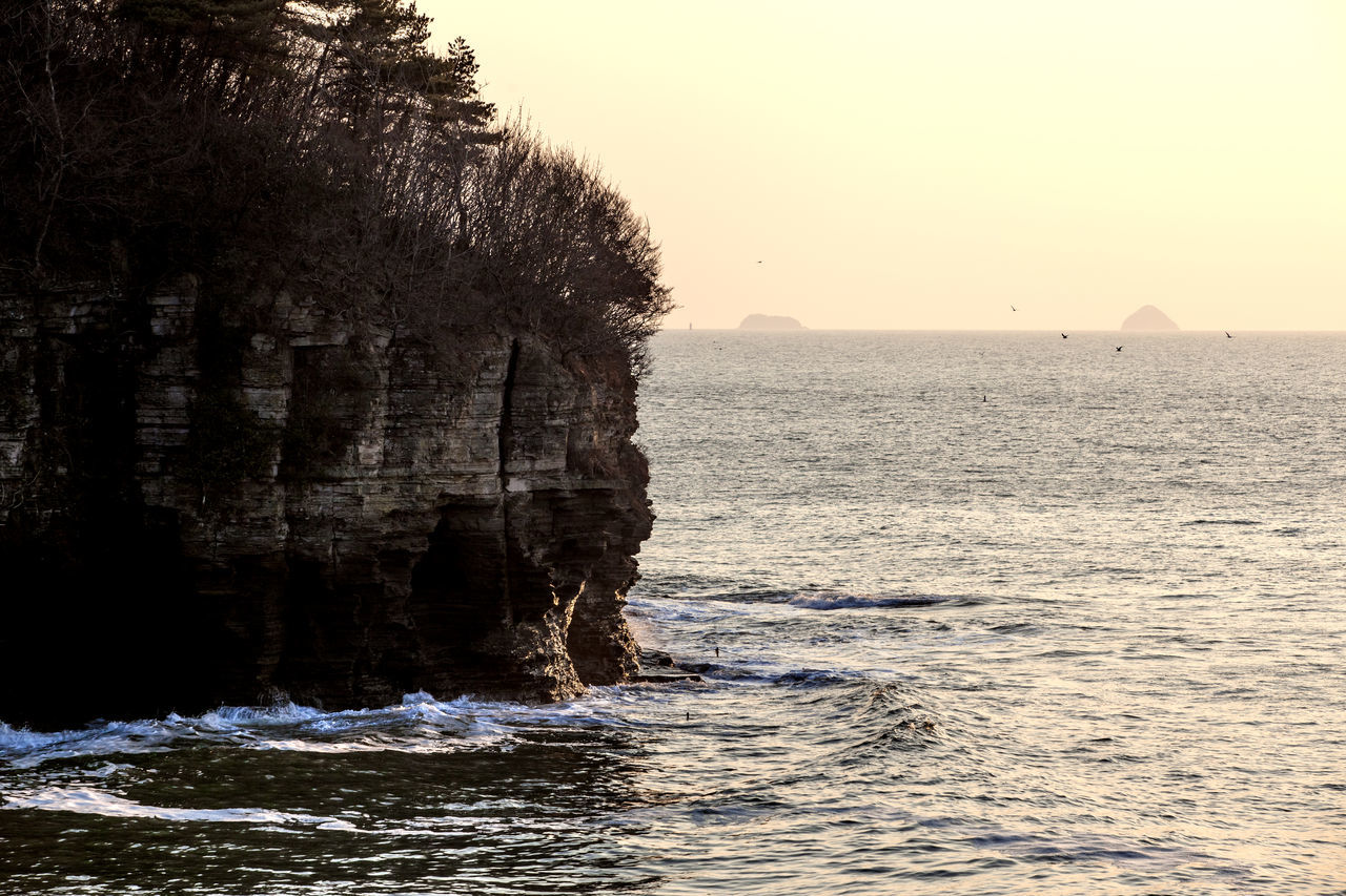 Beauty In Nature Byunsan Cliff Cliffs Escapism Geology Horizon Over Water Nature Outdoors Power In Nature Remote Rock Rock - Object Rock Formation Rocky Scenics Sea Seascape Sunset Tranquil Scene Vacations Water Wave