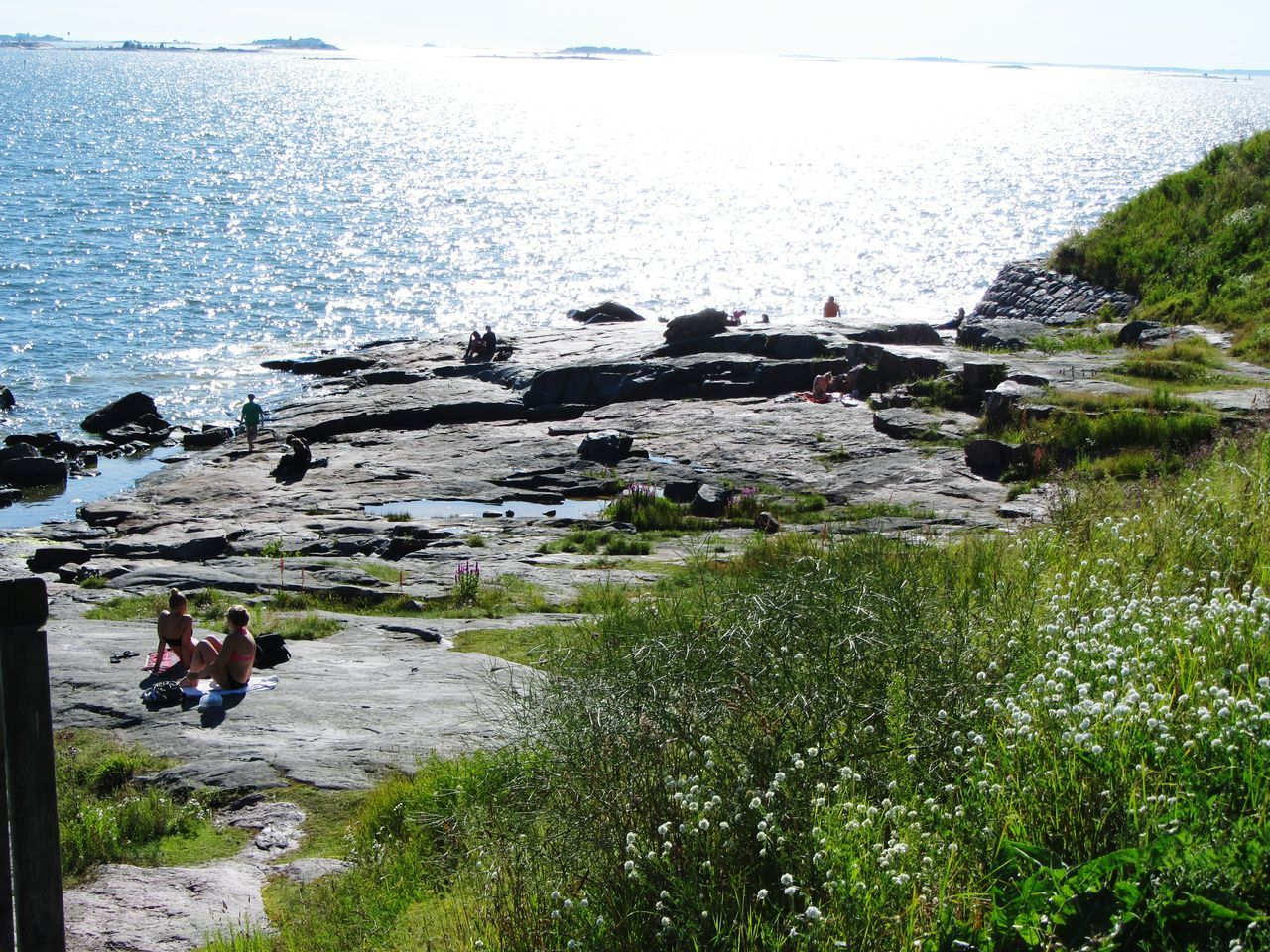 People Relaxing In The Sun On The Rocks Sea Sea And Sky Summertime Sunshine Reflections Horizon Islands Gulf Of Finland