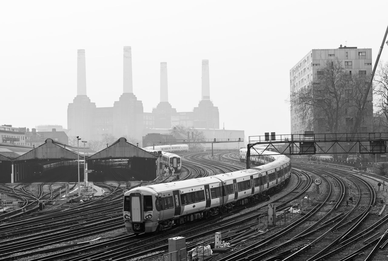 London Lifestyle Industrial landscape with Battersea Power Station London Transportation Rail Transportation Railroad Track Urban Skyline Battersea Power Station Industrial Depression