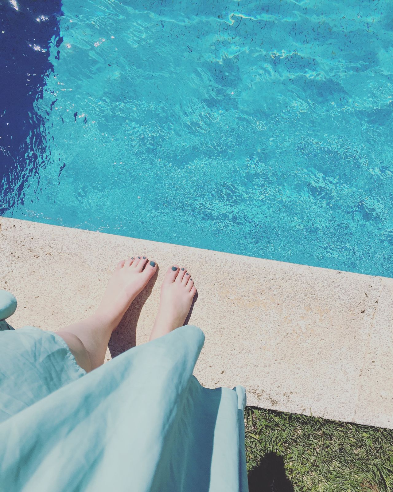 Barefoot Blue Day High Angle View Human Body Part Human Foot Human Leg Leisure Activity Lifestyles Low Section One Person One Woman Only Outdoors Personal Perspective Poolside Real People Relaxation Sea Shadow Summer Sunlight Swimming Pool Vacations Water Women