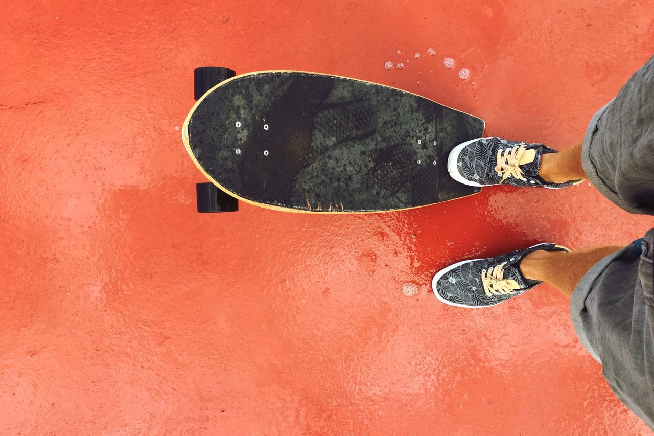 Low Section Human Leg One Person Standing Human Body Part Shoe Real People Only Men One Man Only Lifestyles Adult Adults Only People Red Men Outdoors Day Young Adult Close-up Skate Skateboarding Longboard