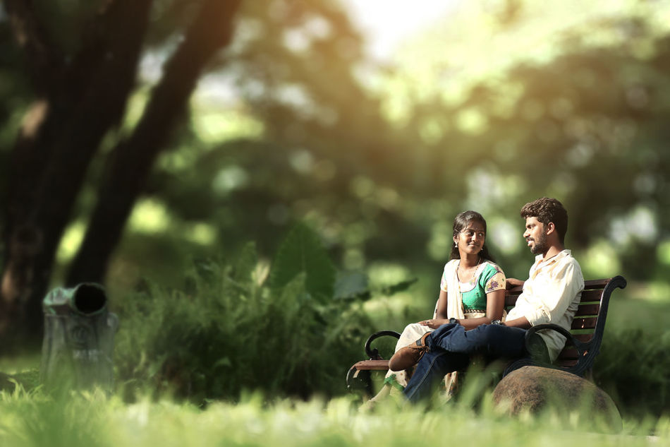Young love Sitting Two People Heterosexual Couple Togetherness Love Romance Adult Grass Relaxation Connection Young Adult People Adults Only Men Couple - Relationship Talking Women Happiness Leisure Activity Dating Portrait Day Nature Beauty In Nature