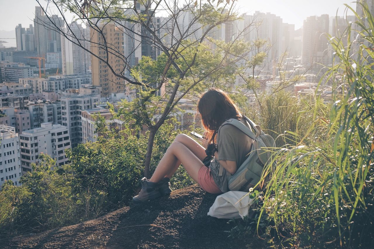 Beautiful stock photos of regen, one person, sitting, young adult, city