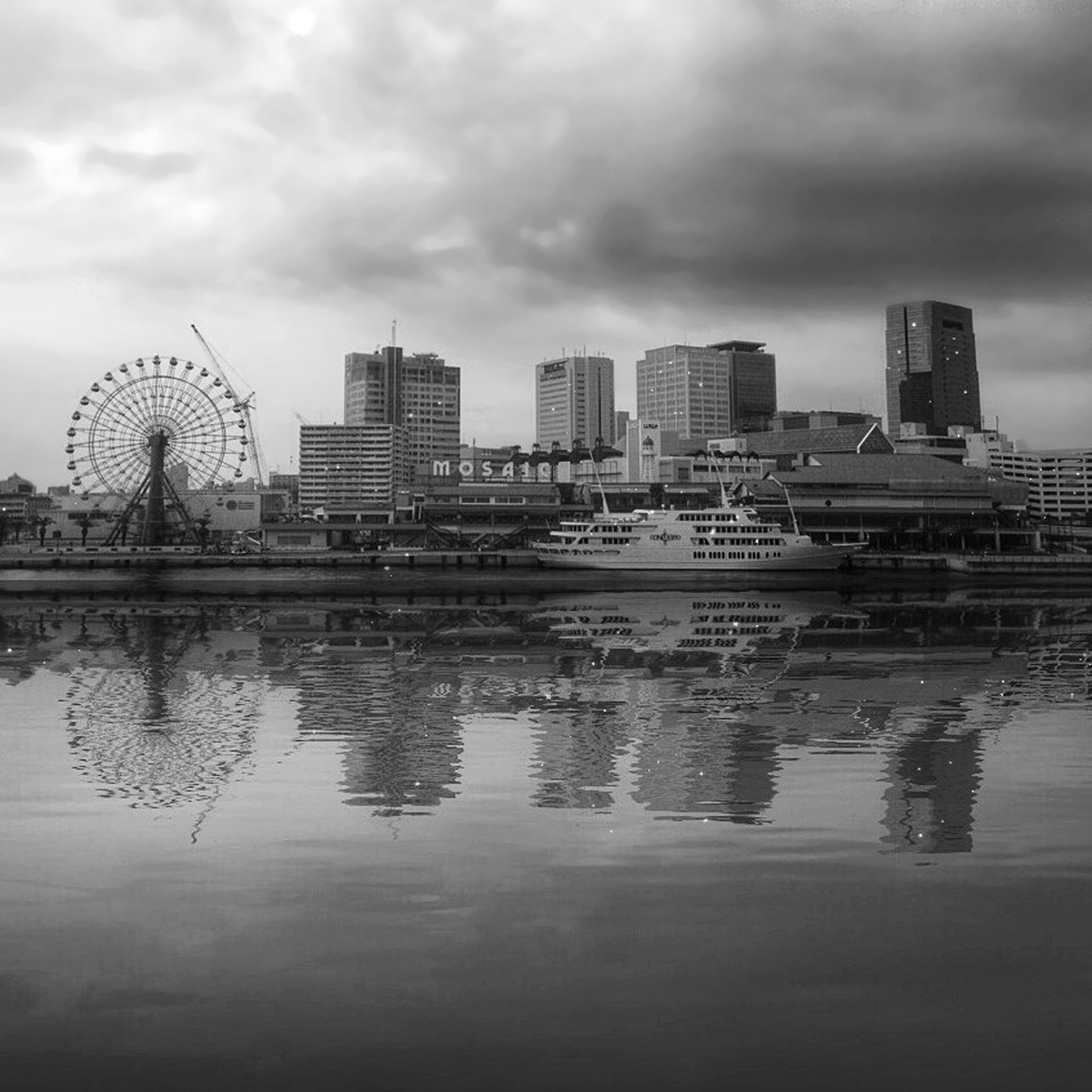 architecture, built structure, building exterior, sky, water, cloud - sky, cloudy, city, reflection, waterfront, river, weather, overcast, modern, cloud, dusk, outdoors, cityscape, tall - high, tower
