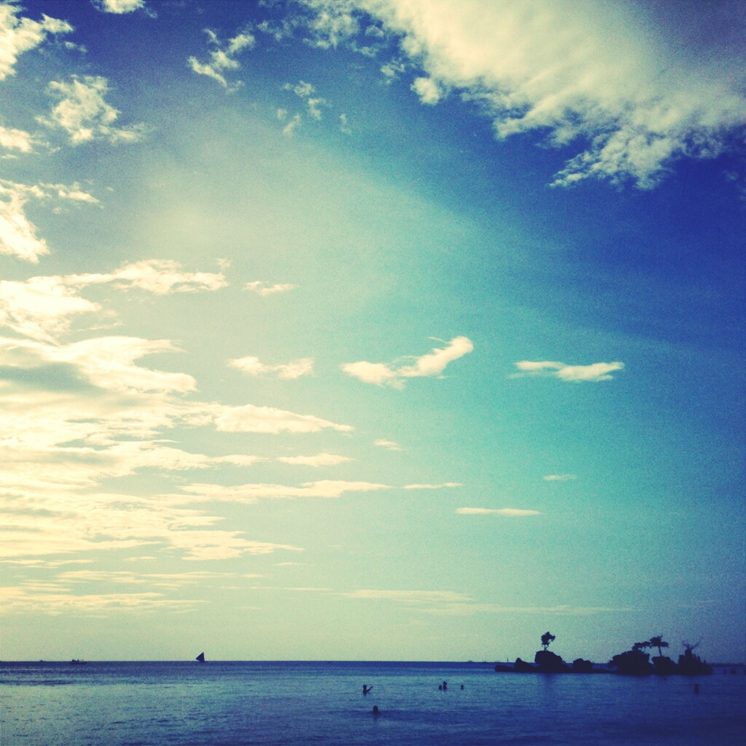 sea, water, sky, horizon over water, scenics, tranquility, tranquil scene, cloud - sky, waterfront, beauty in nature, blue, nature, silhouette, cloud, idyllic, nautical vessel, beach, cloudy, incidental people, outdoors
