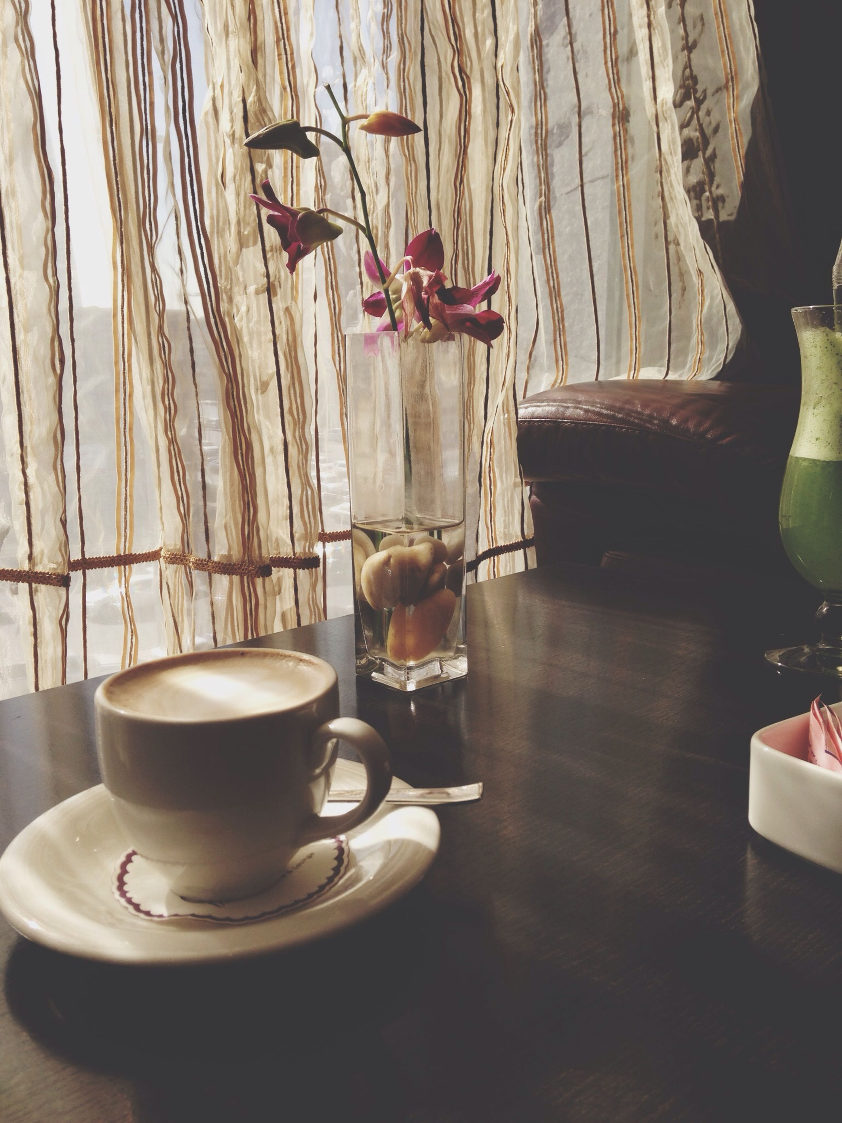 indoors, table, food and drink, chair, drink, coffee cup, still life, freshness, wood - material, home interior, plate, saucer, coffee - drink, spoon, vase, absence, bowl, dining table, refreshment, sunlight