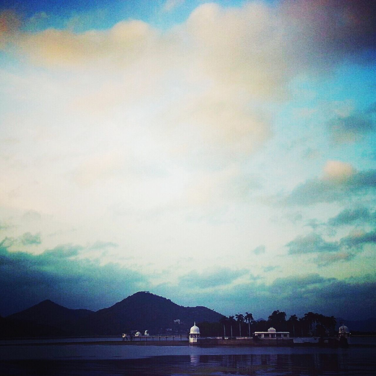 The sky broke like an egg into the sunset and the water caught fire! Hello World Fatehsagar Udaipur_dairies Incredible India A Place You Must Visit Tourist Attraction  Great Atmosphere EyeEm Naturelovers