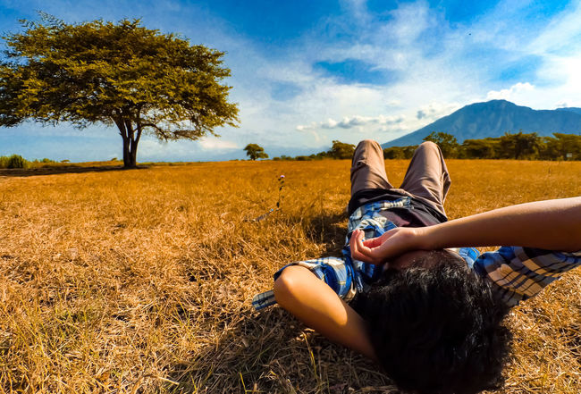 I'd like to make myself believe this planet Earth turns slowly An Eye For Travel Balurannationalpark Baluran INDONESIA Adventure Savannah Travelling Chilling One Person People Sky Summer Lying Down Cloud - Sky Human Body Part Nature Tree Shades Of Winter EyeEmNewHere Love Yourself
