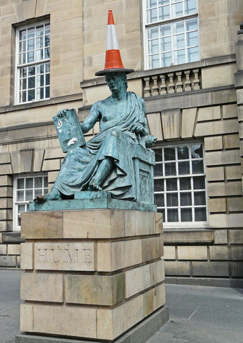 A Taste Of Scotland Cityscape Edinburgh City Hume University Prank Architecture Art And Craft Building Exterior Built Structure City Day History Human Representation Immense Blue Sky No People Outdoors Road Cone Sculpture Sky Statue Travel Destinations The Graphic City