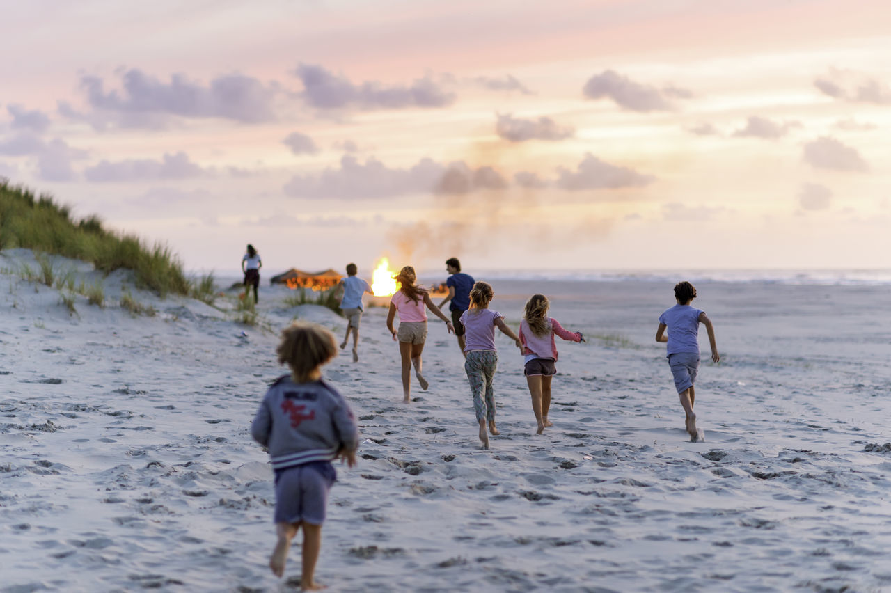 Summer campfire with kids running Beach Beauty In Nature Campfire Campfireflames Dunes Fun Kids Lifestyles Live For The Story Nature Outdoors People Real People Running Sand Sky Summer Summernight Sunset Women
