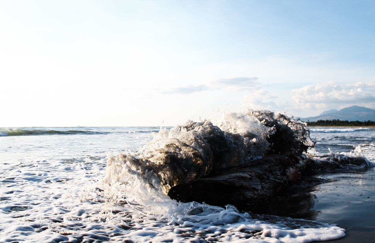 Water Sea Wave Splashing Day Beach Outdoors Nature Motion Sky Shutter Speed No People Wood White Landscape Beauty In Nature Mountain
