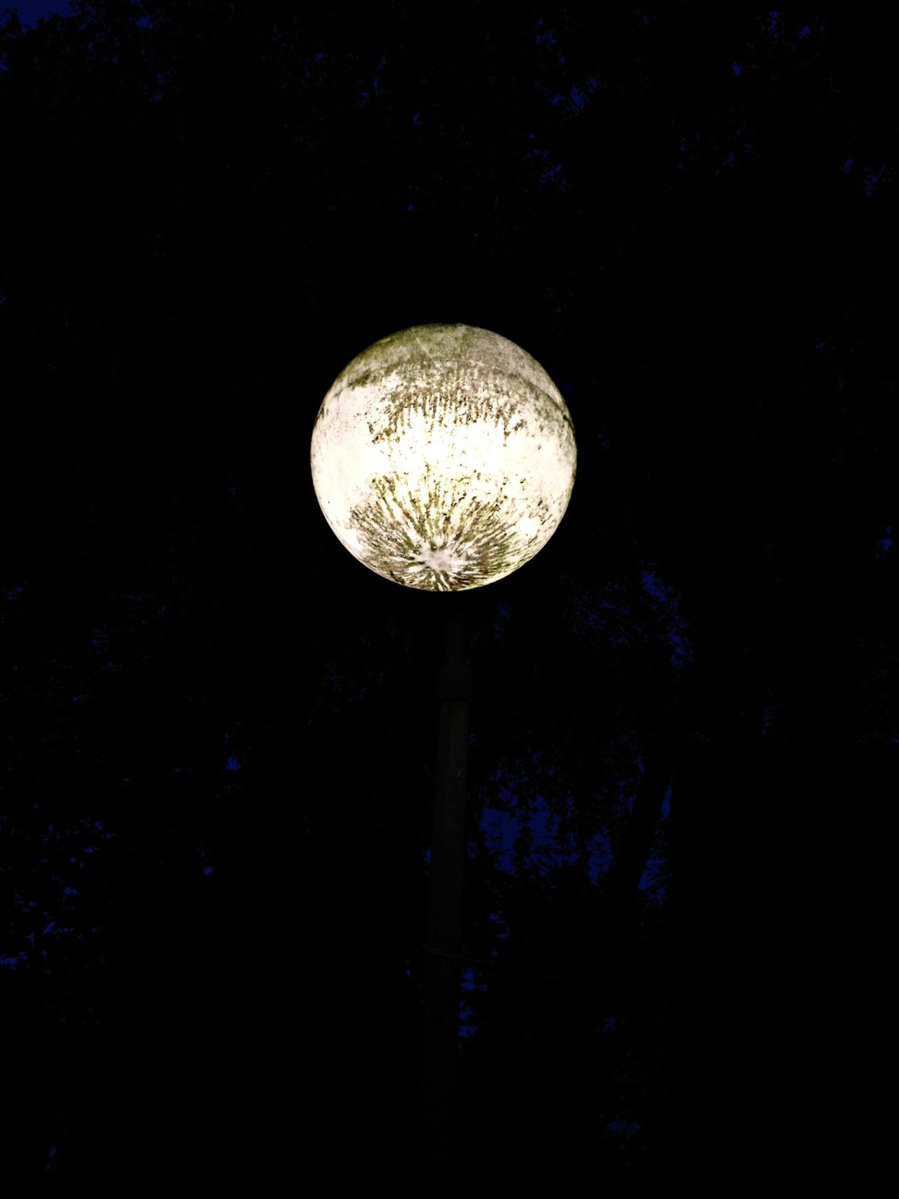 night, low angle view, moon, astronomy, illuminated, full moon, lighting equipment, dark, circle, electricity, sphere, copy space, planetary moon, no people, glowing, sky, electric light, street light, clear sky, light bulb