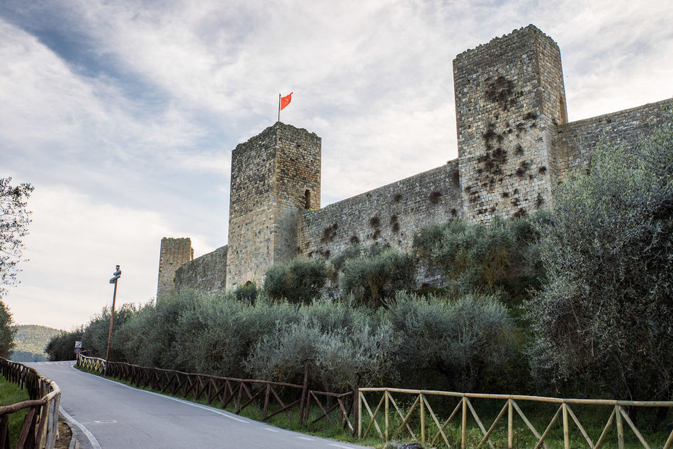 Ancient Architecture Building Exterior Built Structure Castle City Cloud - Sky Clouds Day Flag Historic History Monteriggioni No People Outdoors Patriotism Rural Sky Tower Walls