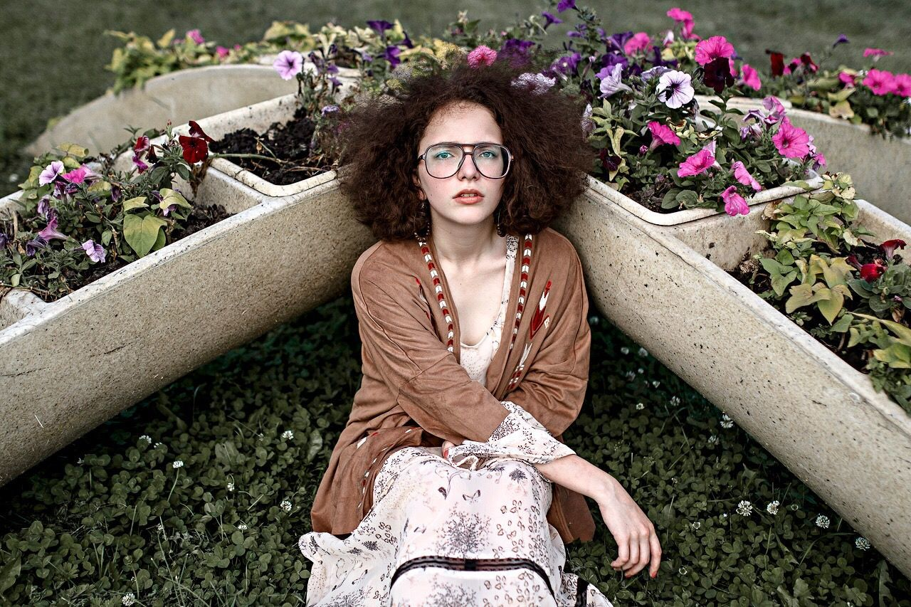 Only Women One Woman Only Eyeglasses  Flower Adult Adults Only Portrait Looking At Camera Beautiful Woman One Young Woman Only People One Person Young Adult Sitting Outdoors Beauty Smiling Nature Day Women Portraitist - 2016 Eyeem Awards EyeEm Best Edits TheWeek On EyEem The Portraitist - 2016 EyeEm Awards EyeEm Awards 2016