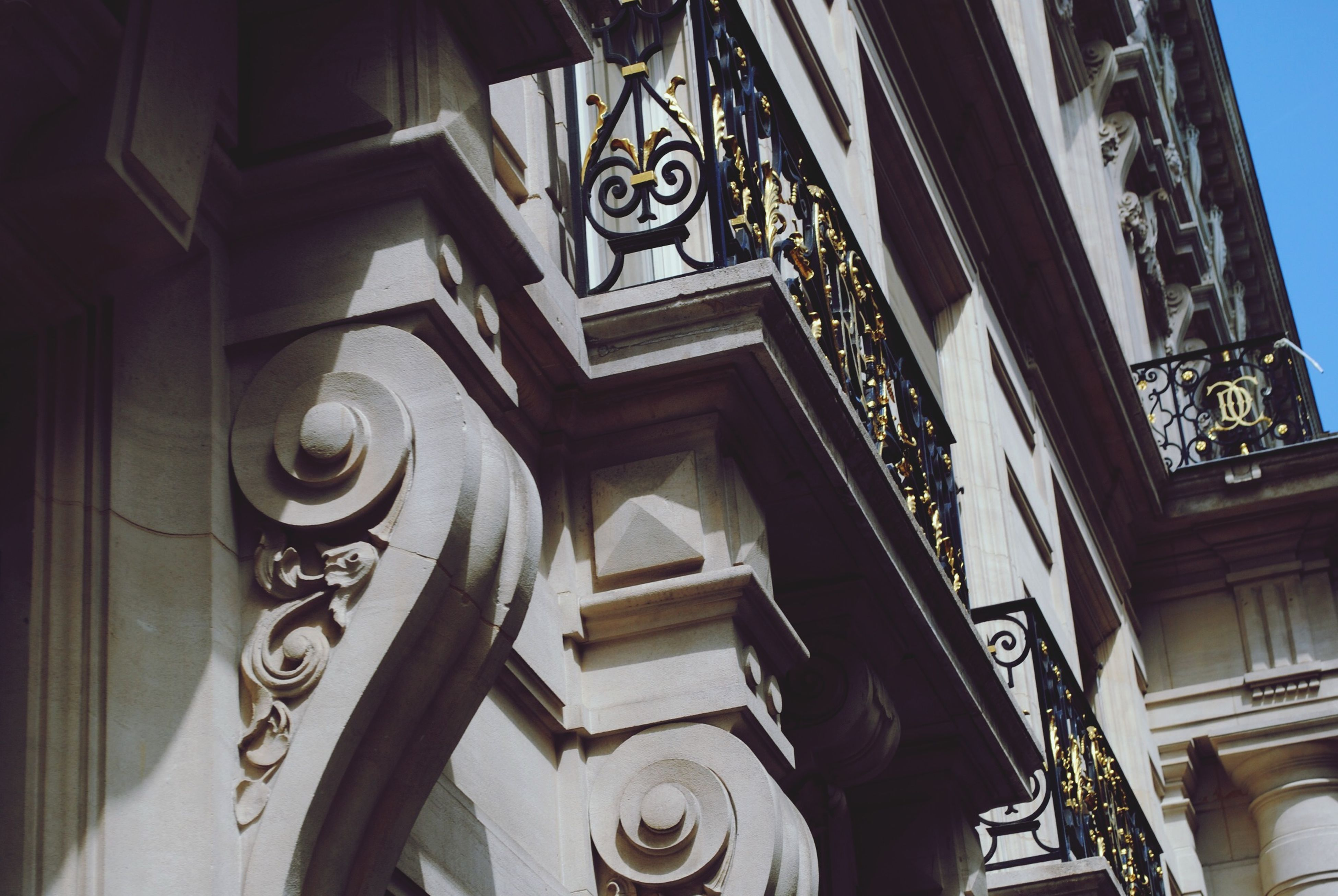 architecture, low angle view, built structure, building exterior, art and craft, art, ornate, creativity, design, carving - craft product, window, building, human representation, history, place of worship, religion, indoors, no people, day, architectural feature