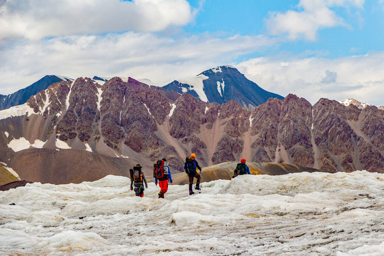 Kyrgyzstan Mountaineering Pamir Mountains Adventure Beauty In Nature Cloud - Sky Day Glacier Leisure Activity Lifestyles Men Mountain Mountain Range Nature Outdoors Pamir People Physical Geography Real People Scenics Sky