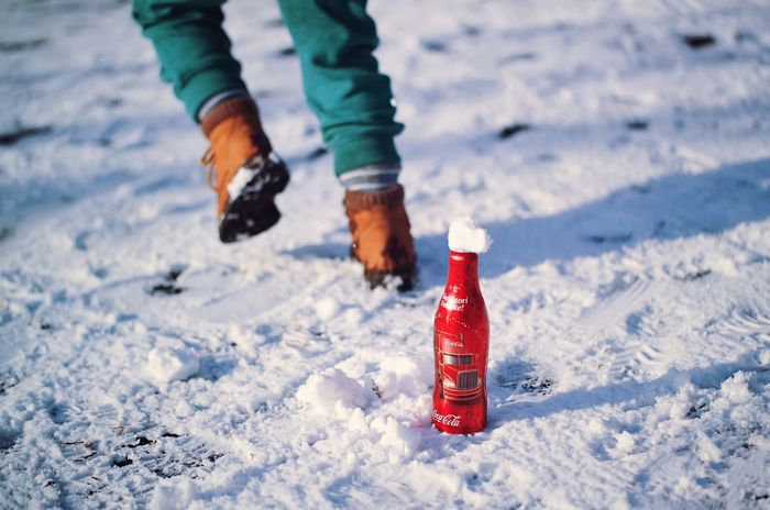 Cold tasty red... Snow Winter Human Body Part Children Only Warm Clothing Close-up Cold Temperature Coke Coke Bottle Cocacola Coca Cola Coca Coca-cola Coke Collection Beverage Bottle Drinks Refreshment Coke Bottles Red Christmas Spirit Holidays Child Playing Tasty