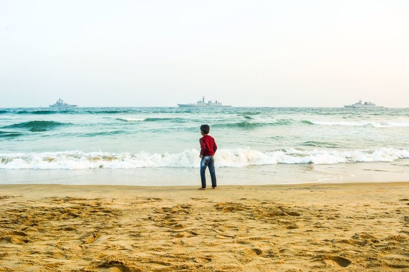 Those waves whisper to me. Photography Love Ships INDIAN NAVY Navyday Evenings Kids Sea Beach Real People One Person Rear View Horizon Over Water Shore Standing Sand Nature Wave Beauty In Nature Sky Scenics Water Vacations Outdoors