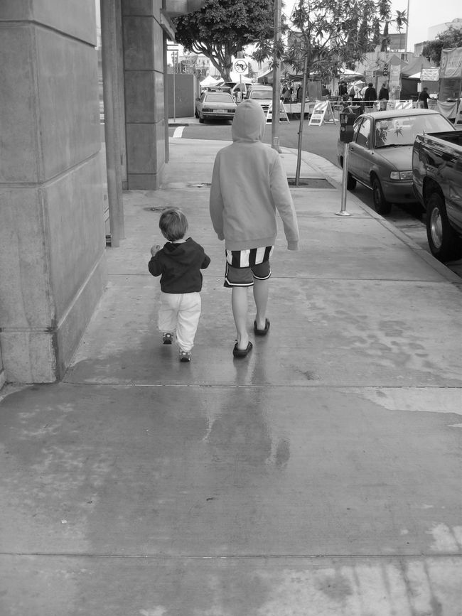 My boys strolling down Hollywood Blvd. to the Farmers Market. Even at 3 or so my youngest could rock a diaper with a lot of tude. Black And White Photography Bondingmoments Farmers Market Hollywood Boulevard Love Bigger Than All My Sons Walking Around The City  Walking With Attitude