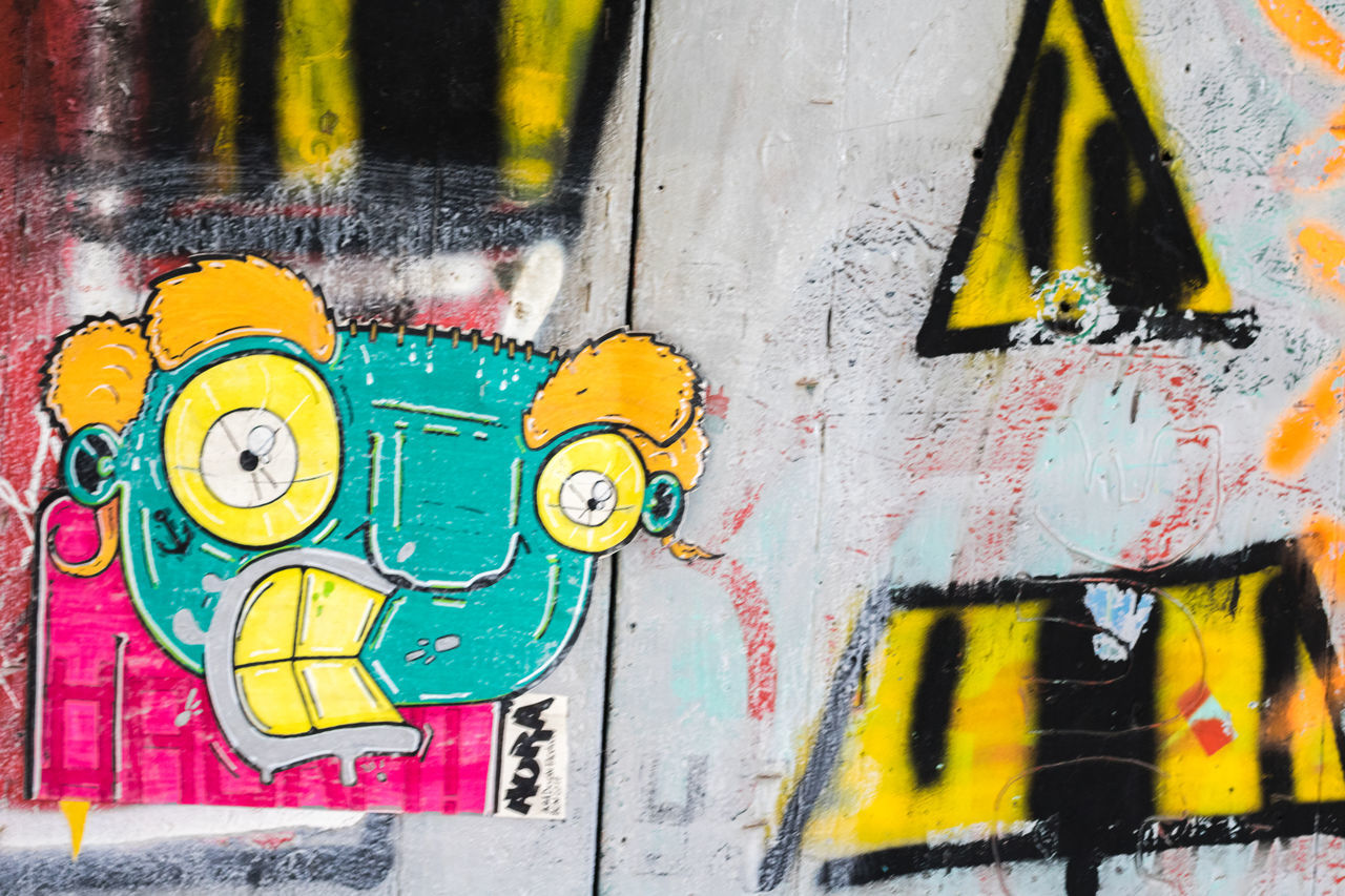 Artwork by Aura Multi Colored Spray Paint Close-up No People Painted Image Outdoors Day Wall Art Wall - Building Feature Urban Cultures Artistic Design Clorful Made With Paper Creativity Barcelona Streetphotography Street Photography Textures Of Barcelona Portrait Of A City Barça Graffiti Stencil Street Art