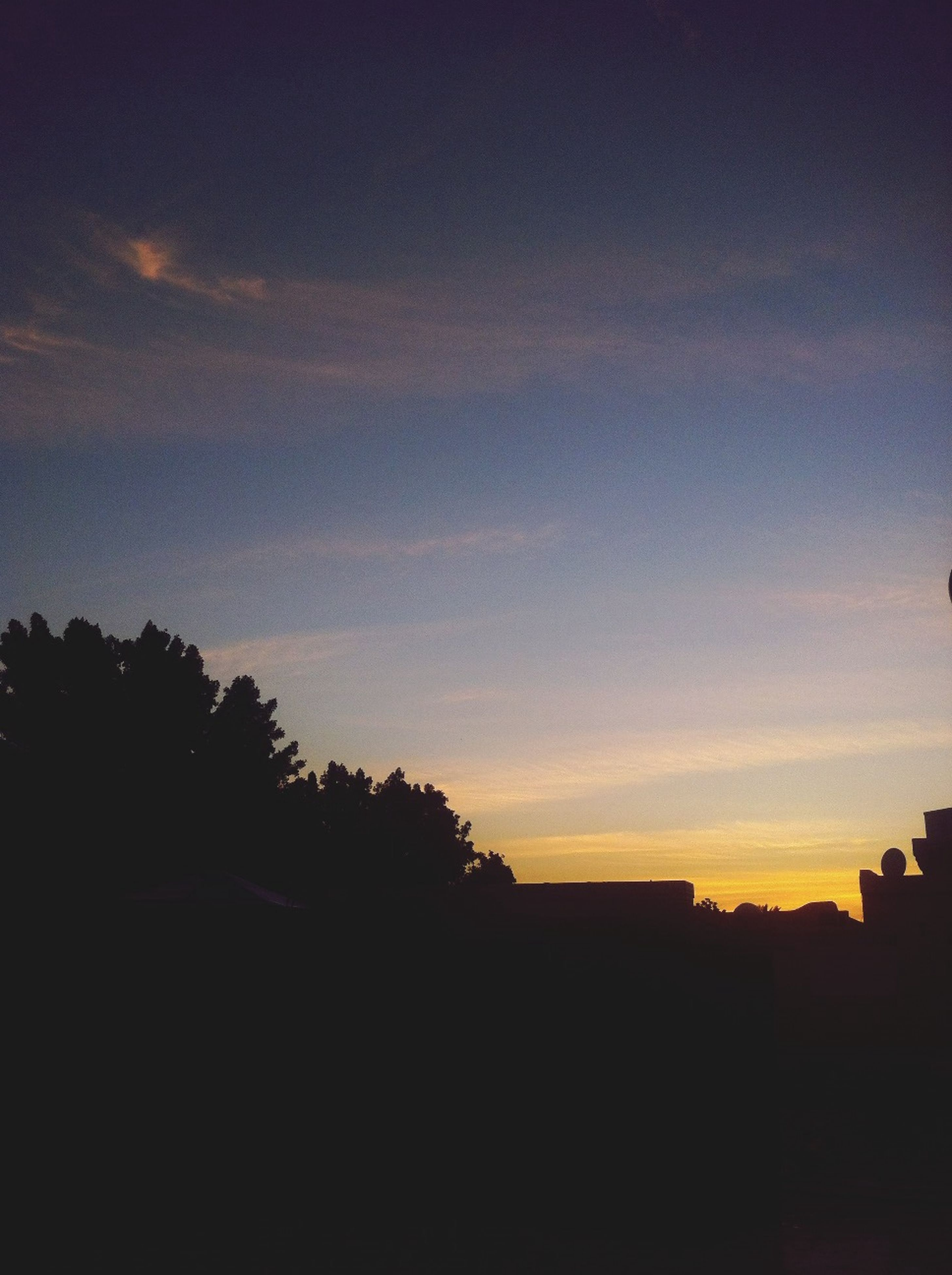 sunset, silhouette, sky, scenics, built structure, tranquil scene, architecture, tranquility, beauty in nature, nature, tree, dusk, building exterior, sea, copy space, idyllic, water, orange color, outdoors, no people