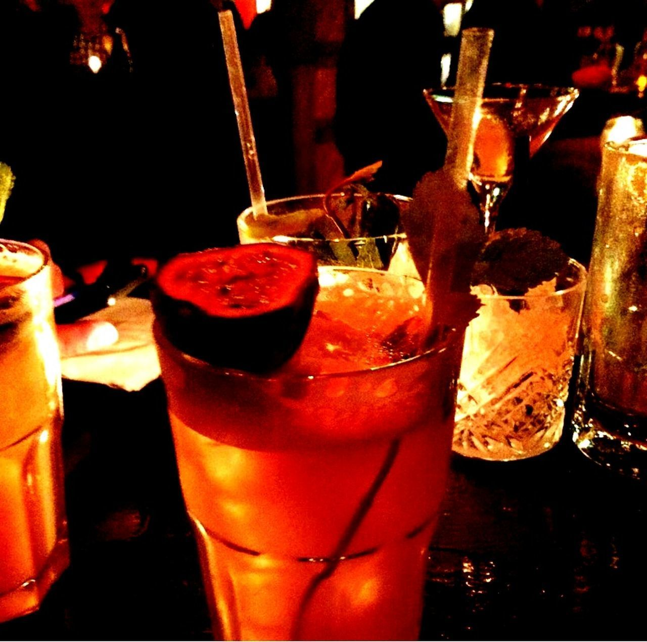 drink, drinking glass, cocktail, alcohol, refreshment, food and drink, drinking straw, ice cube, close-up, no people, indoors, freshness, table, cold temperature, liqueur, bar - drink establishment, night, tropical drink, mojito