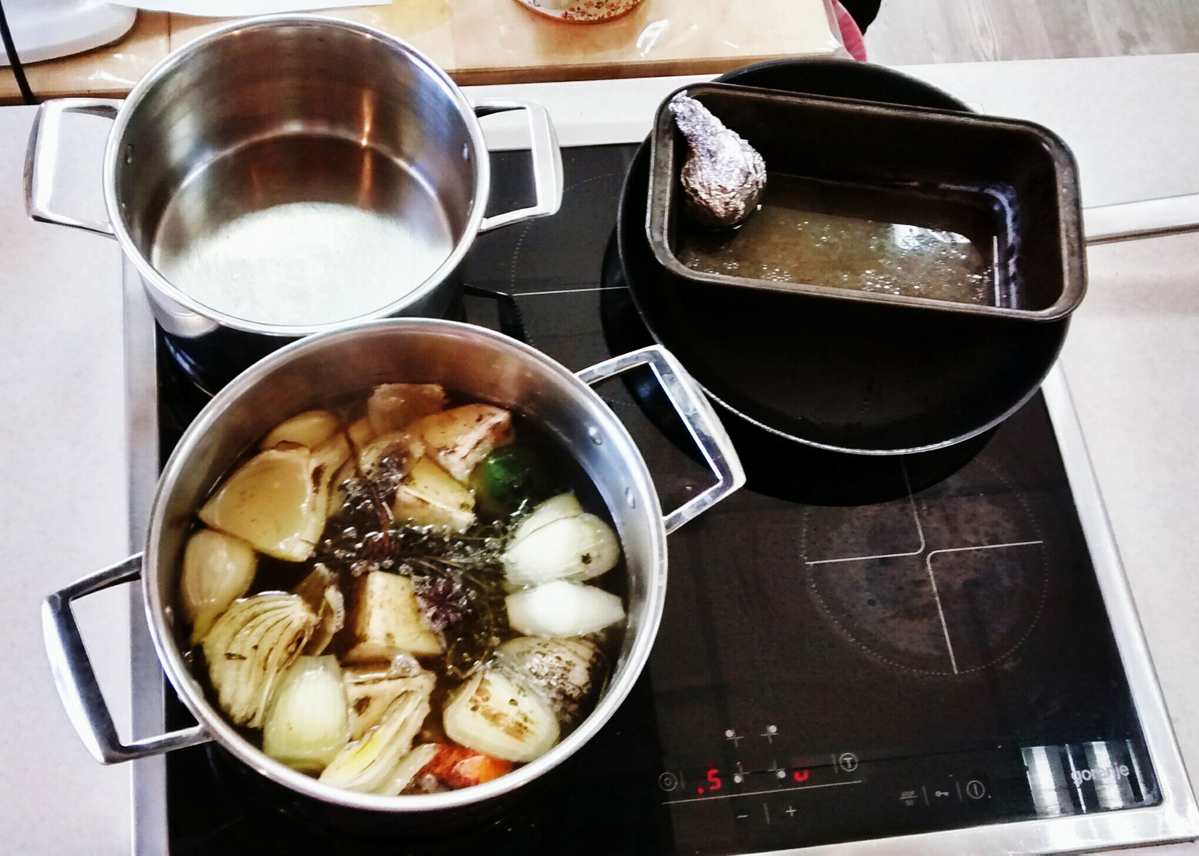 food and drink, food, indoors, freshness, plate, table, healthy eating, still life, ready-to-eat, high angle view, spoon, preparation, cooking, drink, meal, bowl, meat, domestic kitchen, cooking pan, fork