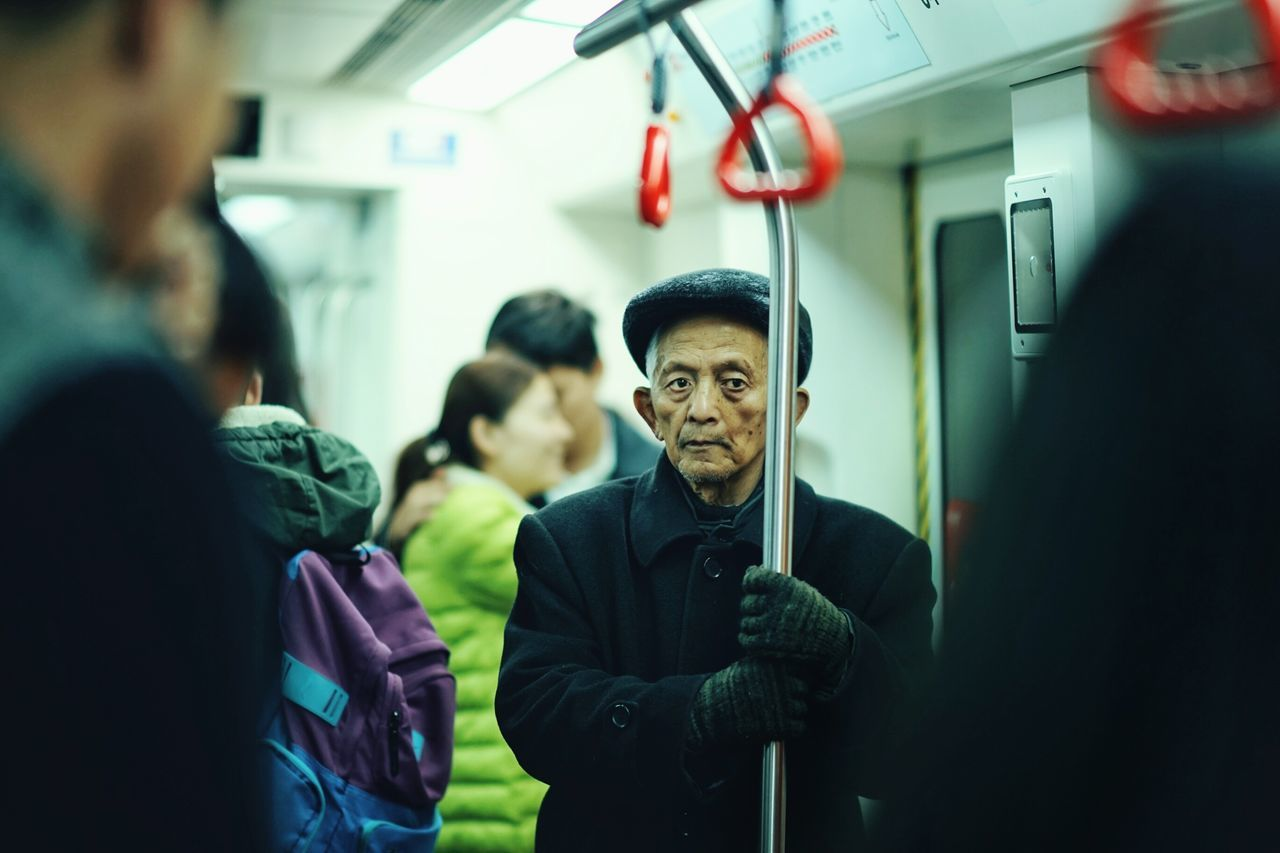 At nanchang metro Streetphotography Street Photography Street Photography China Nanchang Life Around Nanchang Taking Photos Samyang 85mm 1.4 Old People Public Transportation Color Photography Eye4photography  The Portraitist - 2016 EyeEm Awards My Commute EyeEm x Mashable - My Commute People And Places Snap A Stranger