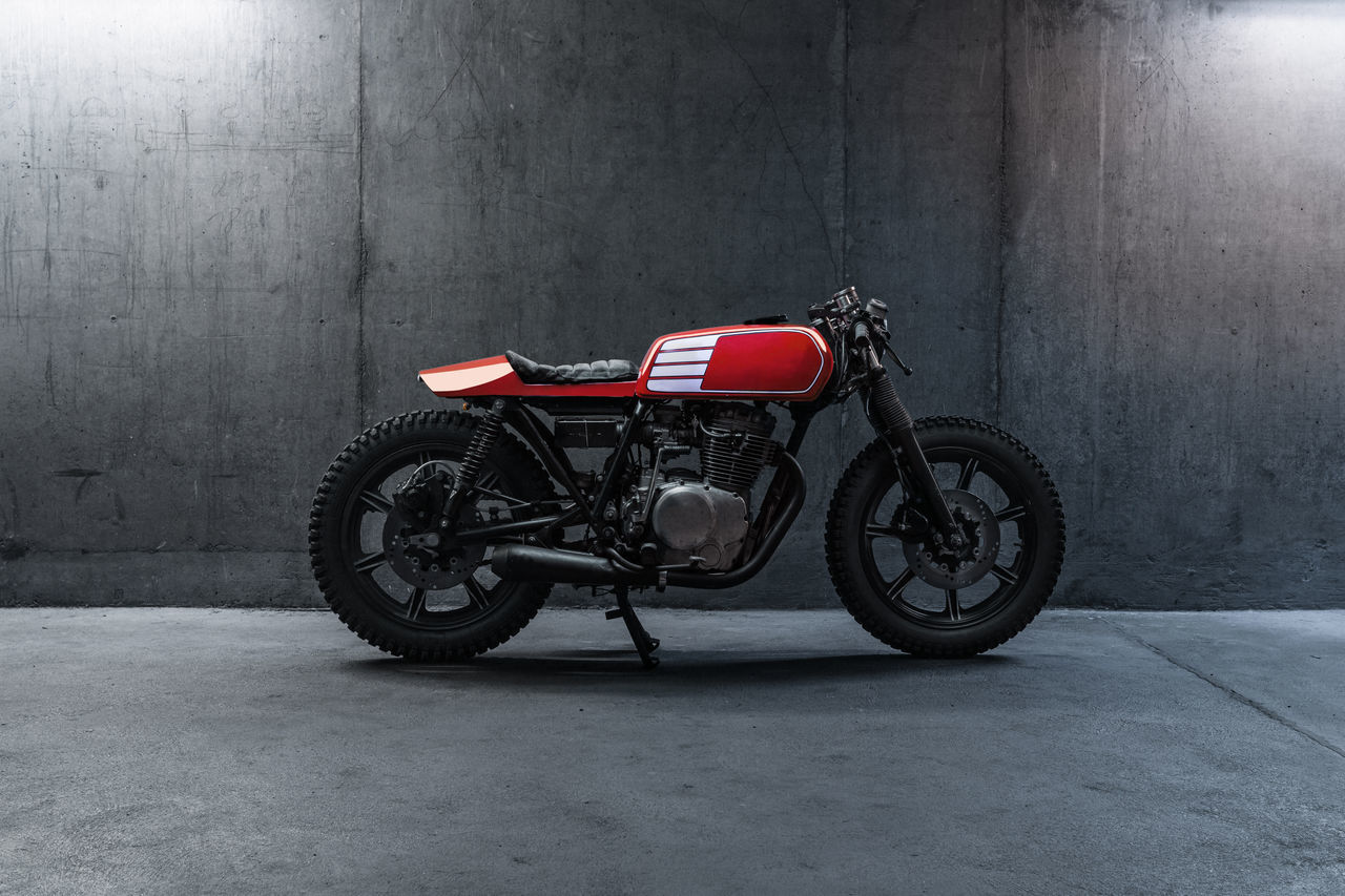 Selfmade male Motorcycle Garage Horsepower Male Mechanic Motorcycles No People Red Selfmade Stationary Strength Transportation