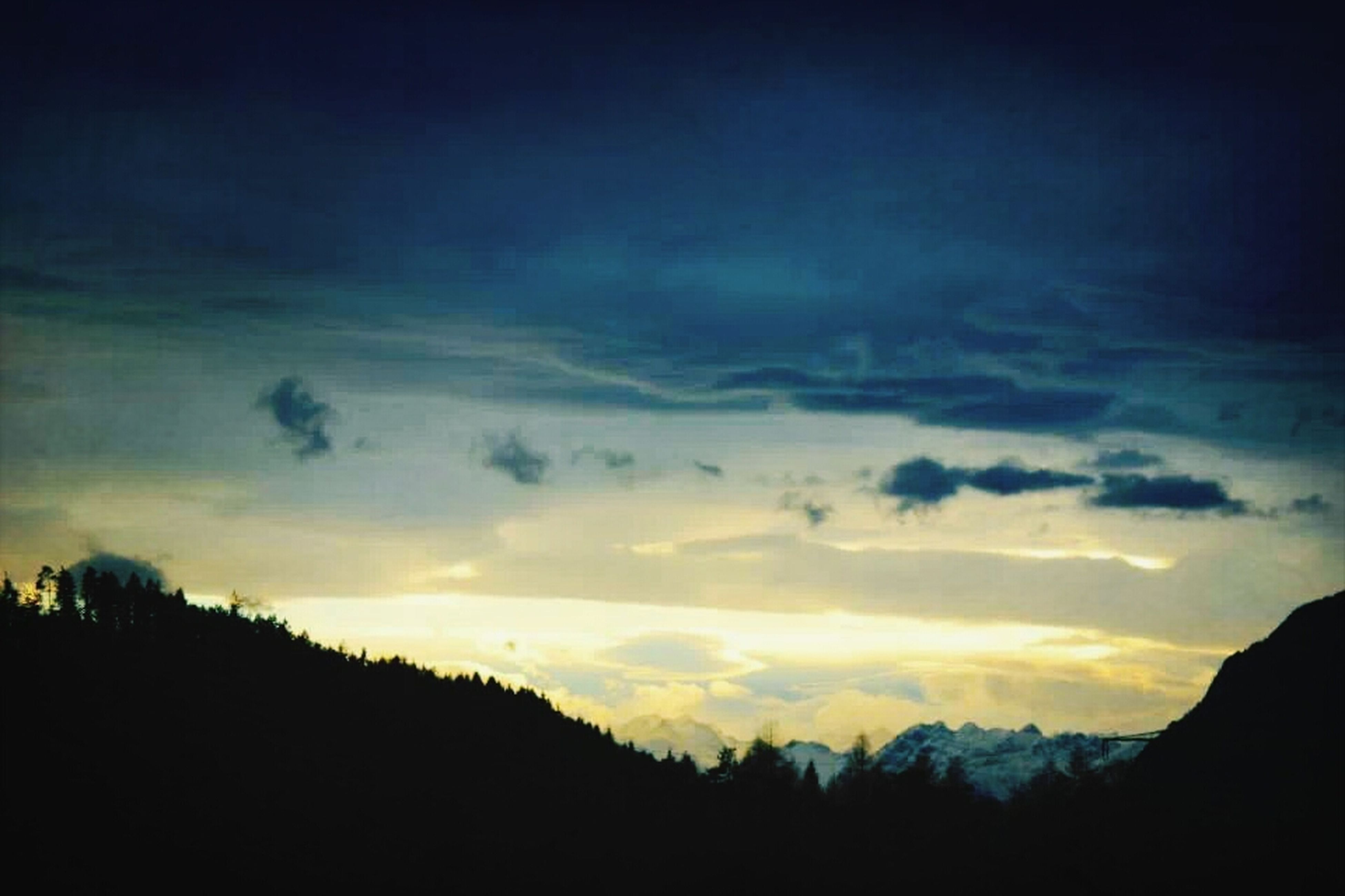 silhouette, tranquil scene, scenics, tranquility, sky, beauty in nature, sunset, cloud - sky, nature, mountain, landscape, tree, idyllic, dusk, dark, cloud, non-urban scene, outdoors, cloudy, no people