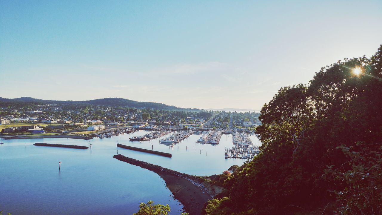 water, no people, nature, transportation, outdoors, tree, architecture, built structure, scenics, mountain, day, tranquility, beauty in nature, sky, nautical vessel, building exterior, sea, cityscape, city