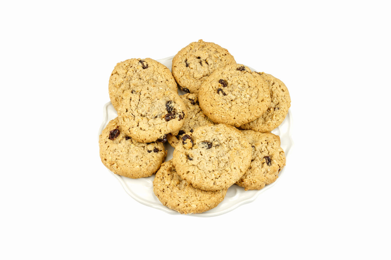 Chocolate chip cookies on plate against a white background. Chocolate Chip Cookies Desert Food Plate Sweet Tasty White Background