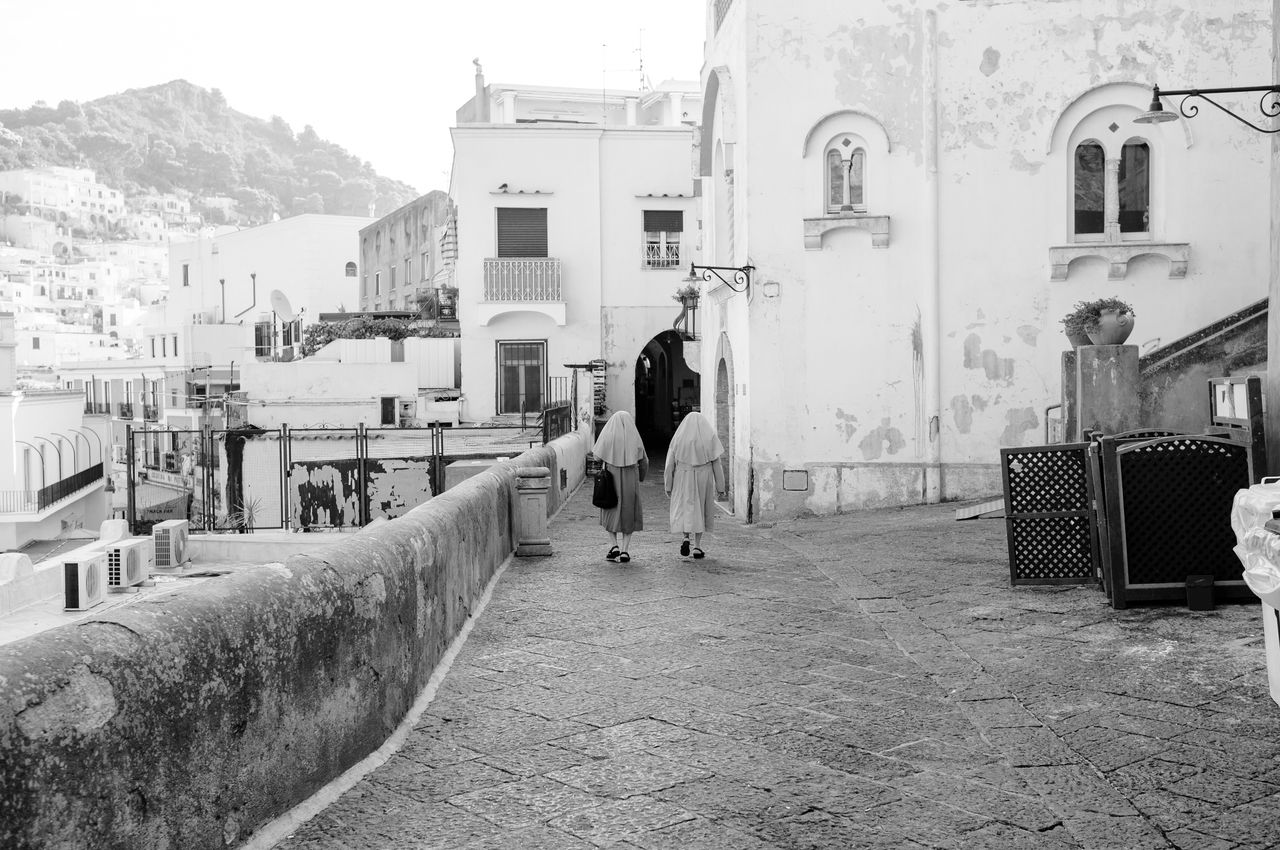 8:25 am Buongiorno Capri Capri Capri, Italy Building Exterior Built Structure Architecture Real People Rear View Walking City Outdoors Women Day People Urban Street Photography Travel Photography Black & White Urban Exploration Black And White Morning Black And White Photography Two People Earlybird Morning Light