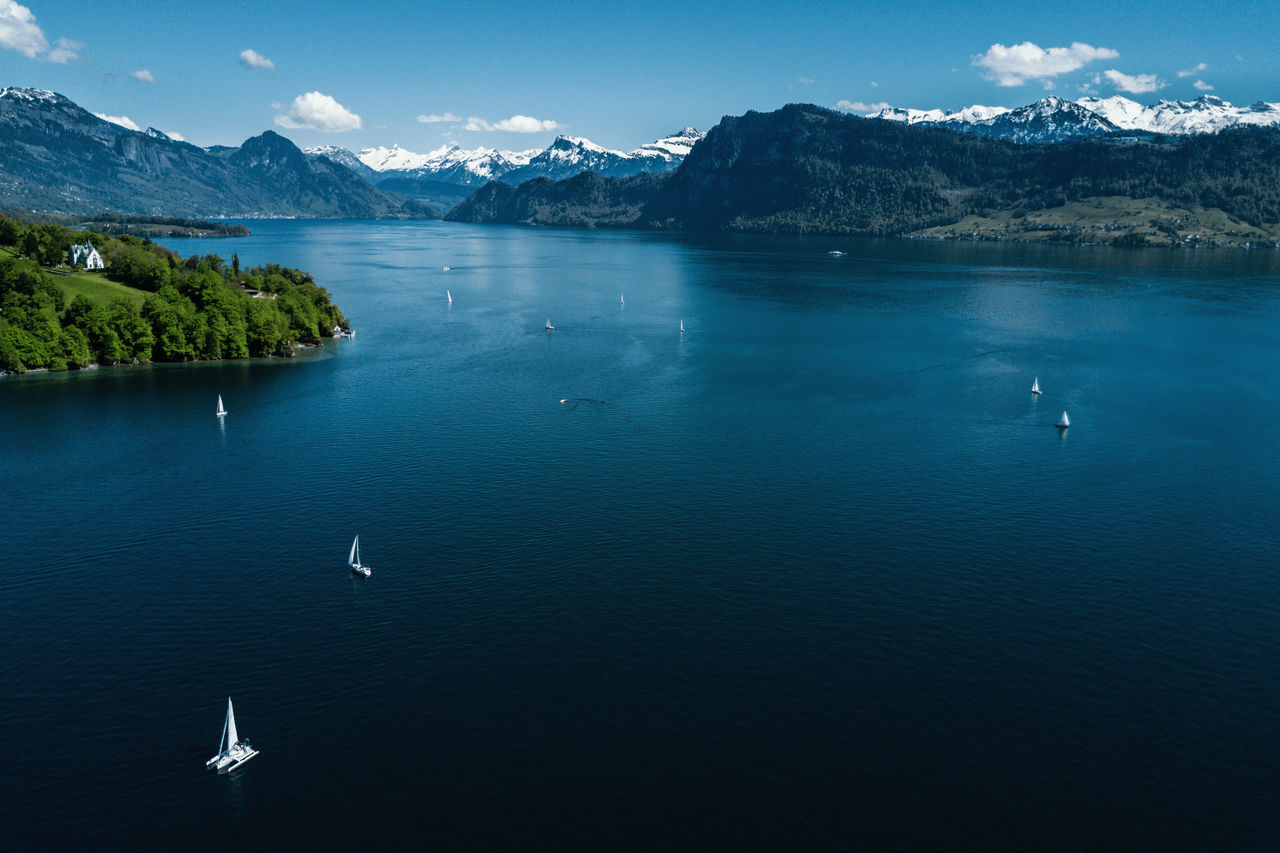 Beauty In Nature Boating Boats Dronephotography Lake Lake Lucerne Landscape Mountain Mountain Range Nature Outdoors Sailing Boat On Lake Sailing Boats Scenics Tranquil Scene Water Waterfront Aerial Shot
