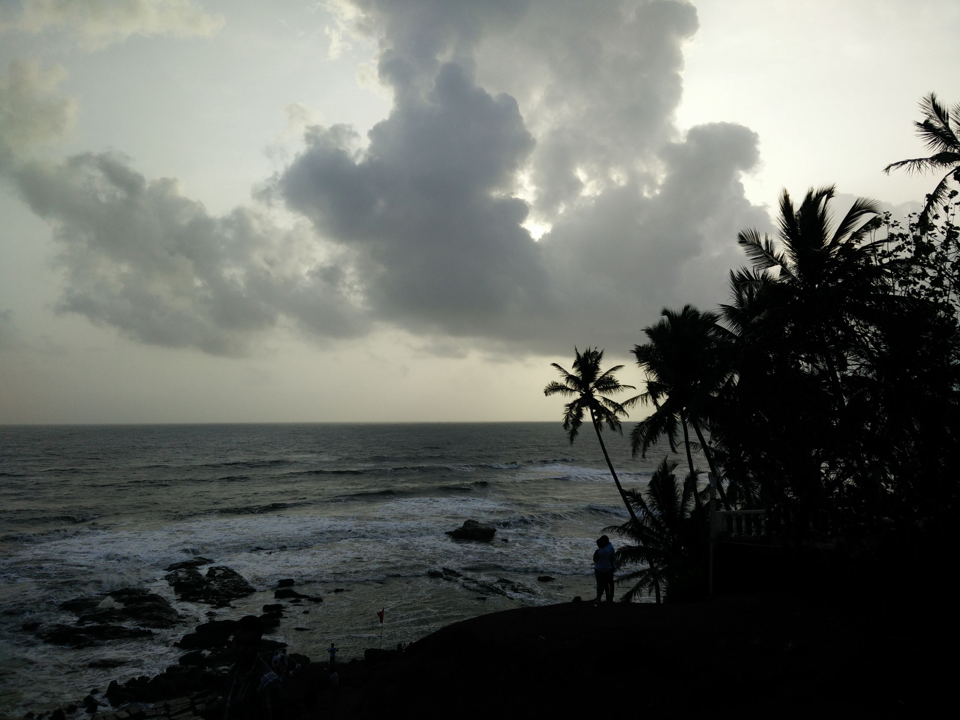 sea, horizon over water, sky, water, tranquil scene, tranquility, scenics, beauty in nature, cloud - sky, tree, nature, beach, cloud, idyllic, silhouette, shore, cloudy, outdoors, remote, coastline