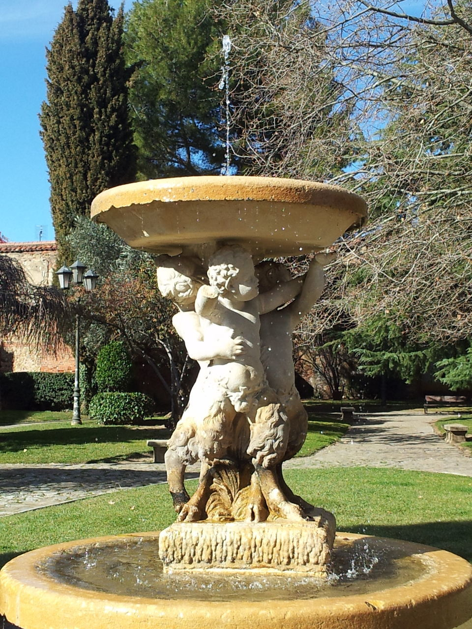statue, fountain, sculpture, art and craft, tree, creativity, water, human representation, day, drinking fountain, park - man made space, outdoors, topiary, no people, growth, nature, architecture, beauty in nature, sky