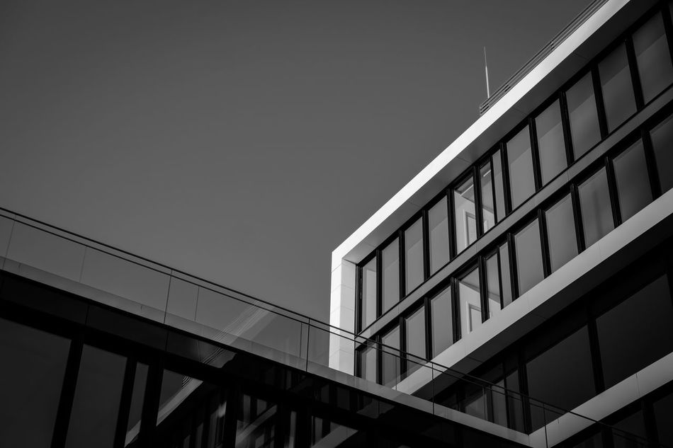 Working II Architecture Building Story Built Structure City Clear Sky Day Geometric Shape Low Angle View Office Building