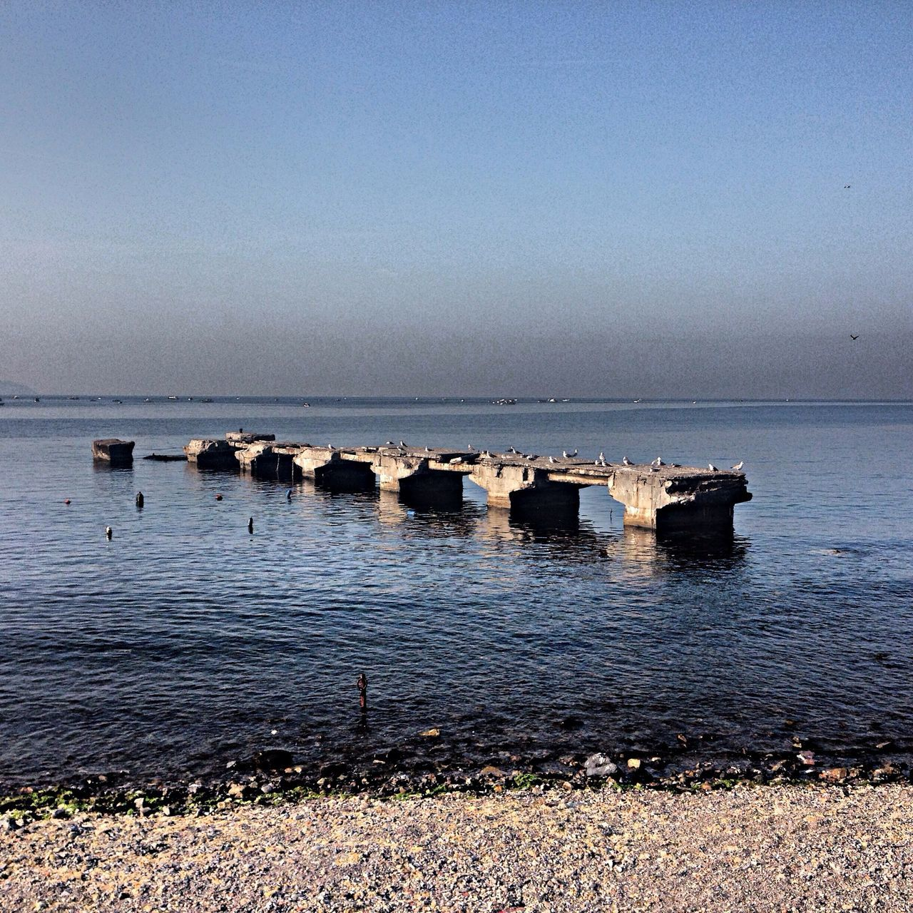 water, sea, horizon over water, tranquil scene, clear sky, tranquility, scenics, copy space, beauty in nature, nature, beach, rippled, sky, nautical vessel, calm, idyllic, seascape, blue, shore, day