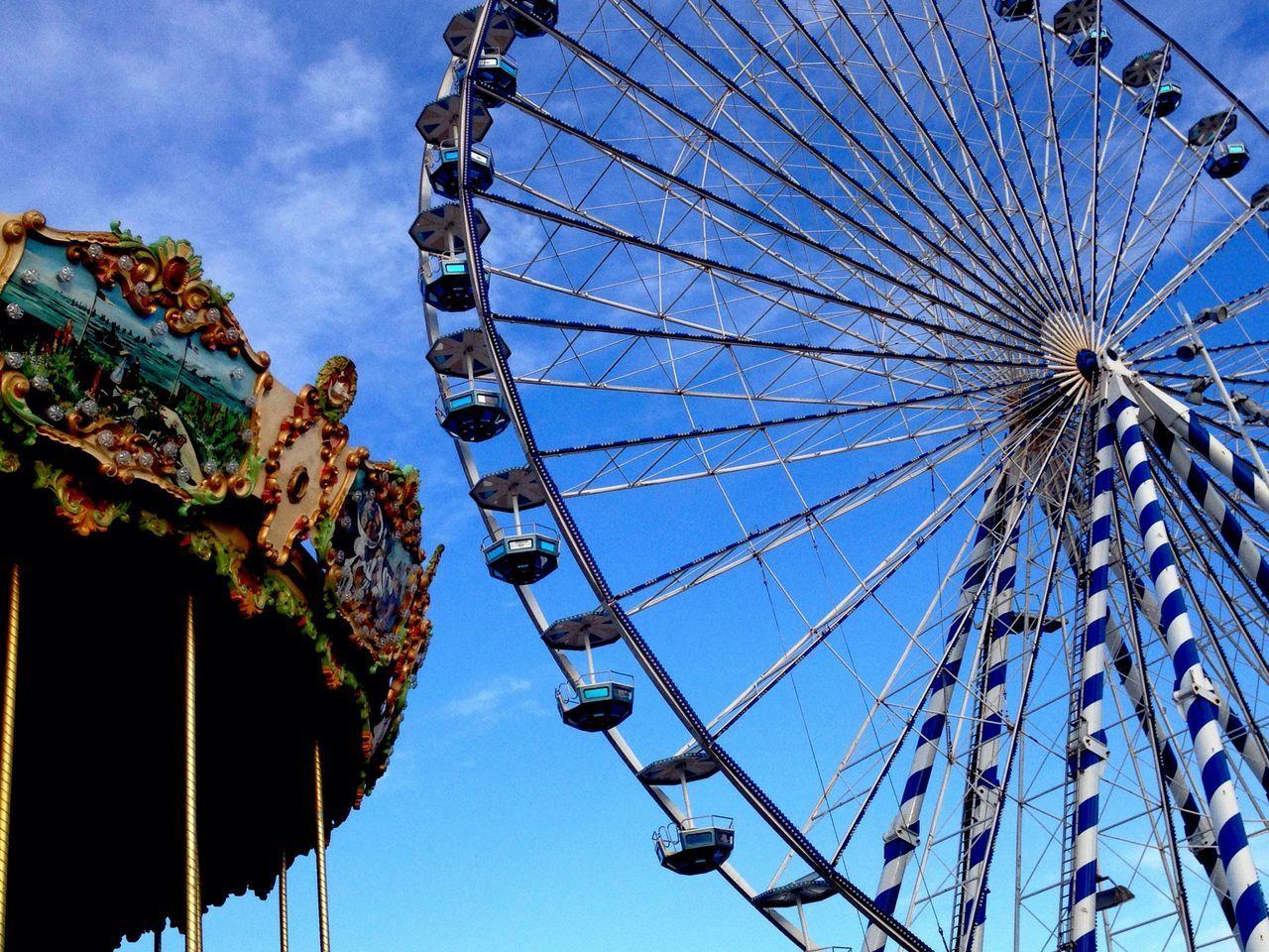 low angle view, amusement park, arts culture and entertainment, amusement park ride, no people, ferris wheel, sky, day, outdoors, blue, big wheel, built structure, clear sky, carousel