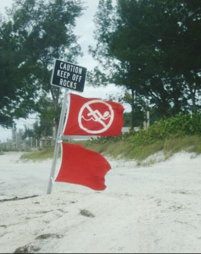 No swimming. Red flags out Red Flag Warning No Swimming Stormy Weather Not A Good Day For The Beach Beach Photography Outdoor Photography Stay Out Of The Water Gulf Of Mexico Anna Maria Island Florida Heed The Warning