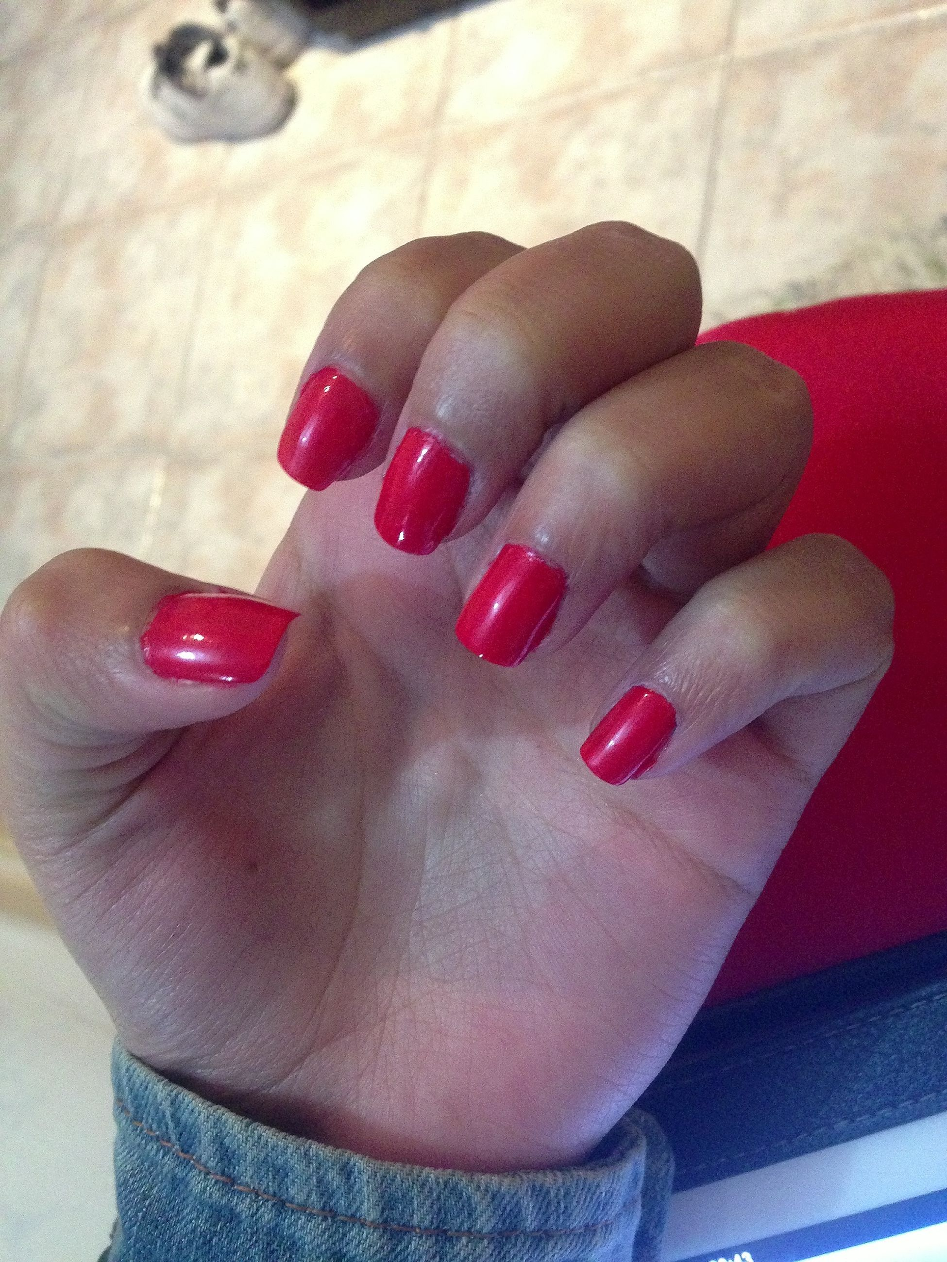 person, indoors, part of, holding, cropped, human finger, lifestyles, red, personal perspective, high angle view, nail polish, close-up, leisure activity, unrecognizable person, home interior